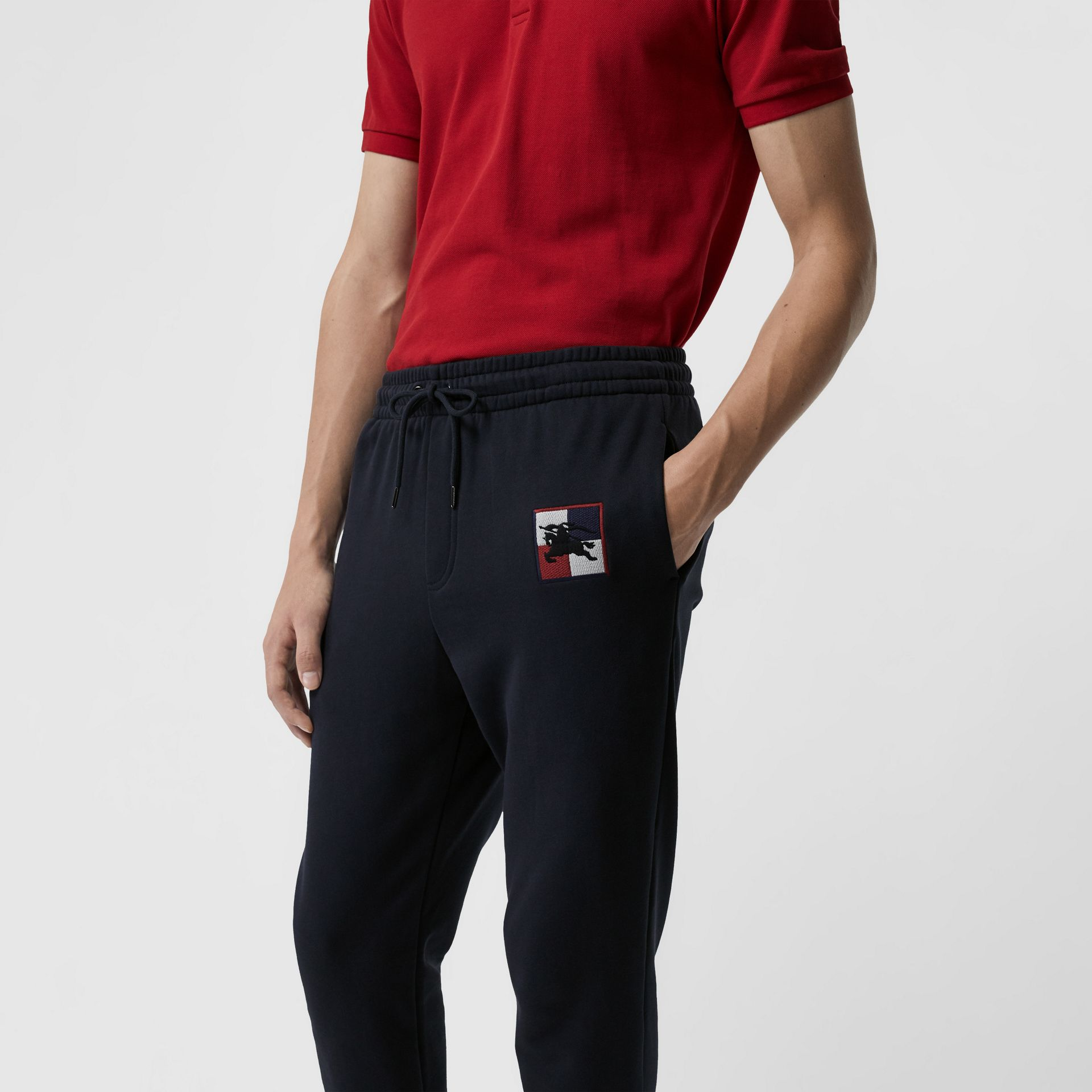 Chequer EKD Cotton Trackpants in Navy - Men | Burberry United Kingdom - gallery image 1