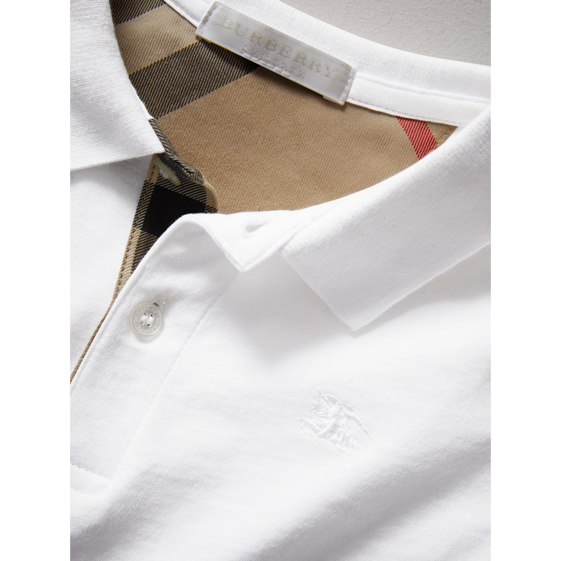 Long-sleeve Cotton Jersey Polo Shirt in White - Boy | Burberry - gallery image 1