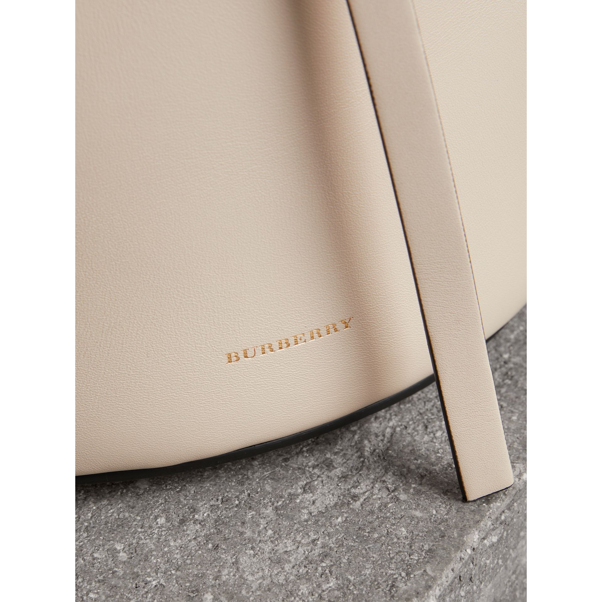 The Small Leather Bucket Bag in Limestone - Women | Burberry - gallery image 1