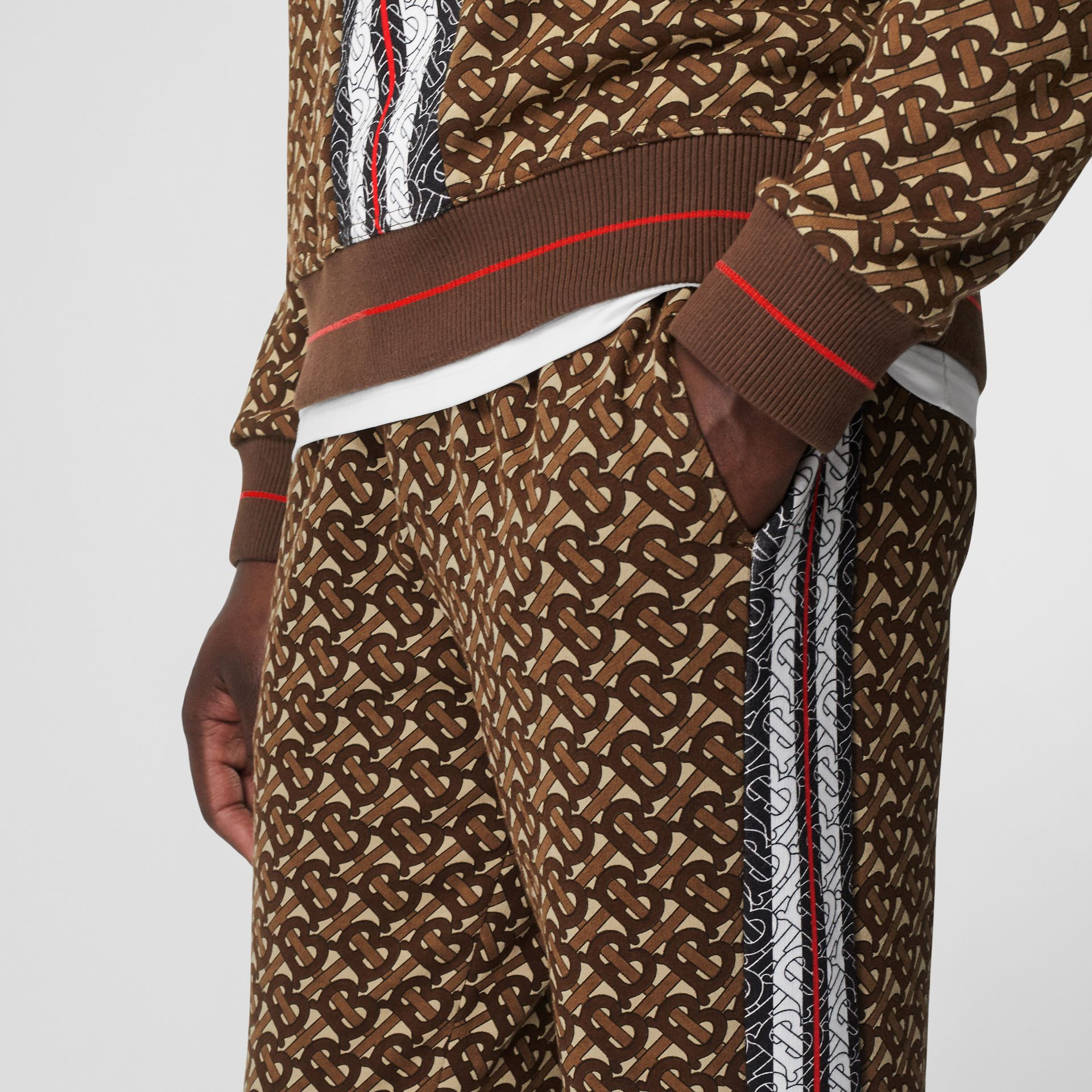 Monogram Stripe Print Cotton Trackpants in Bridle Brown - Men | Burberry - gallery image 1