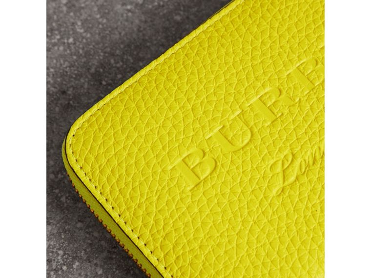 Embossed Leather Ziparound Wallet in Bright Yellow - Women | Burberry United Kingdom - cell image 1
