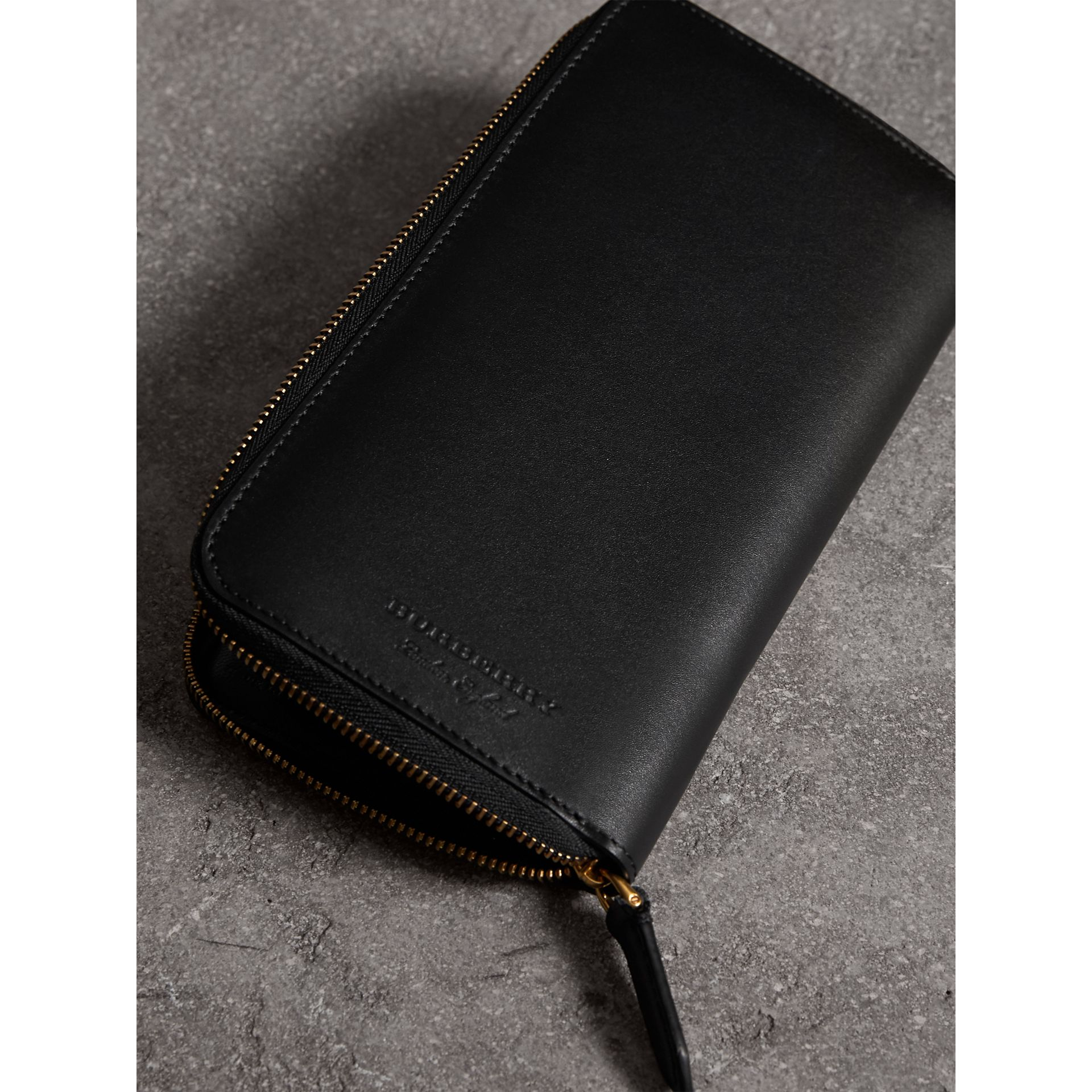 Riveted Leather Ziparound Wallet in Black - Men | Burberry - gallery image 2