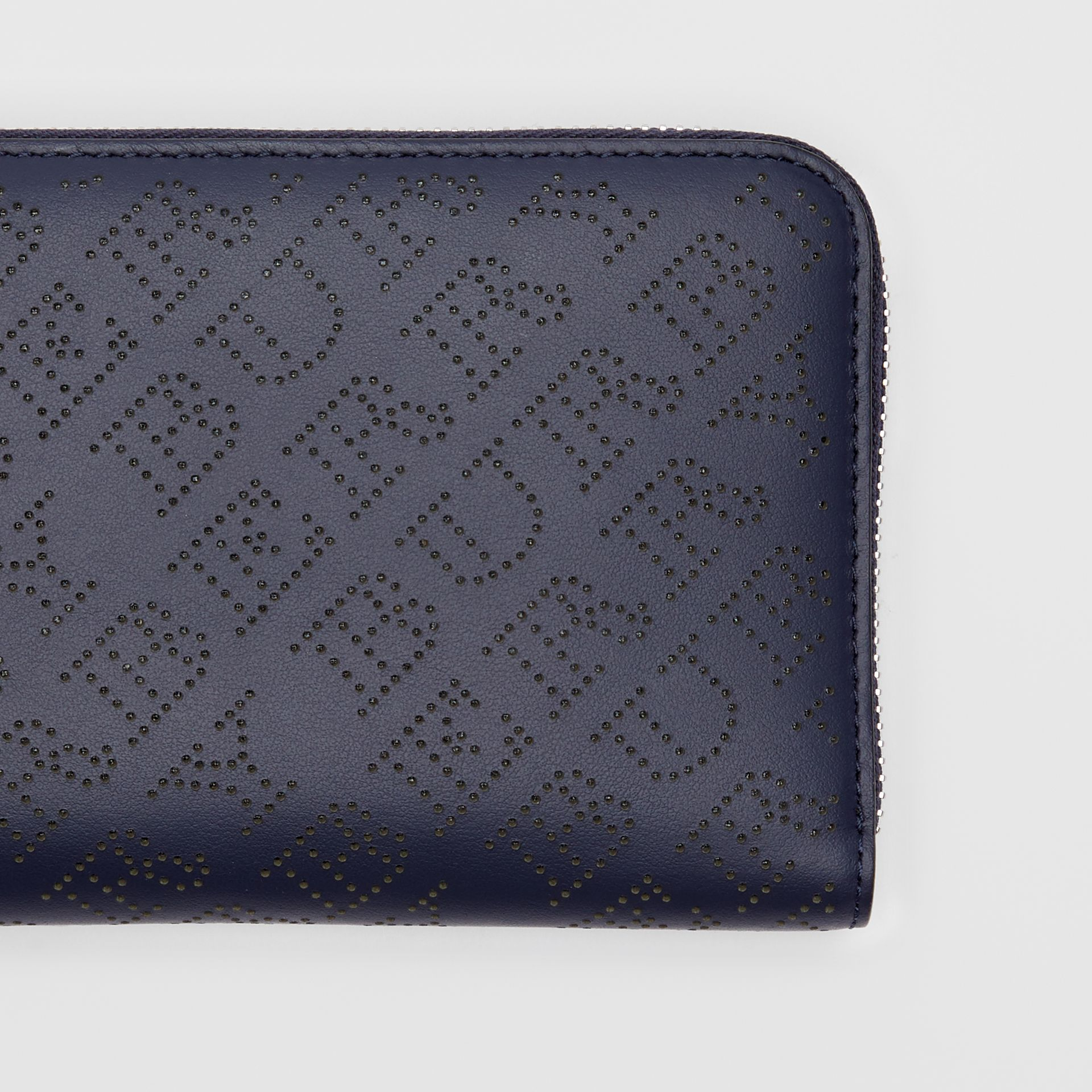 Perforated Leather Ziparound Wallet in Navy - Women | Burberry - gallery image 1