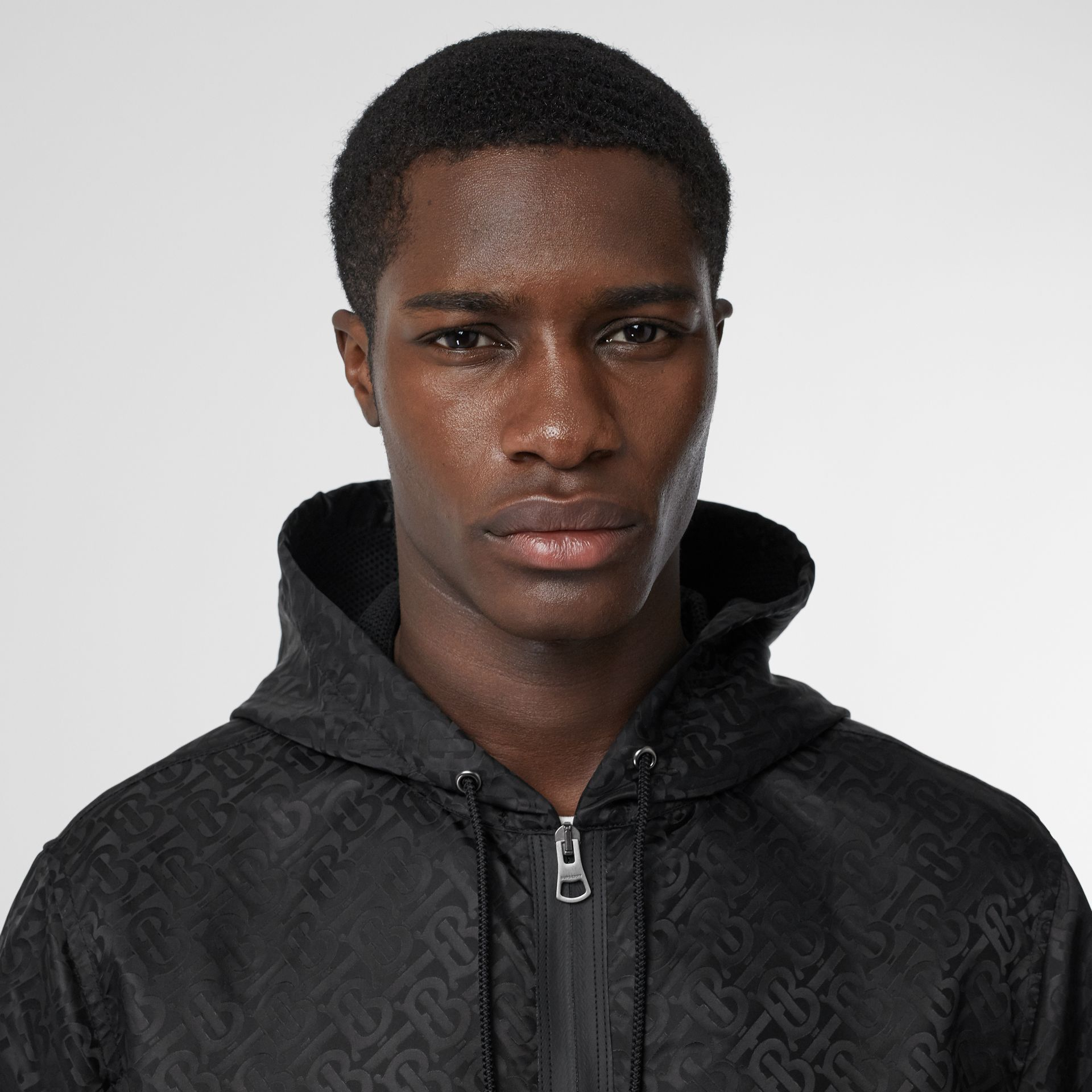 Monogram ECONYL® Jacquard Hooded Jacket in Black - Men | Burberry - gallery image 1