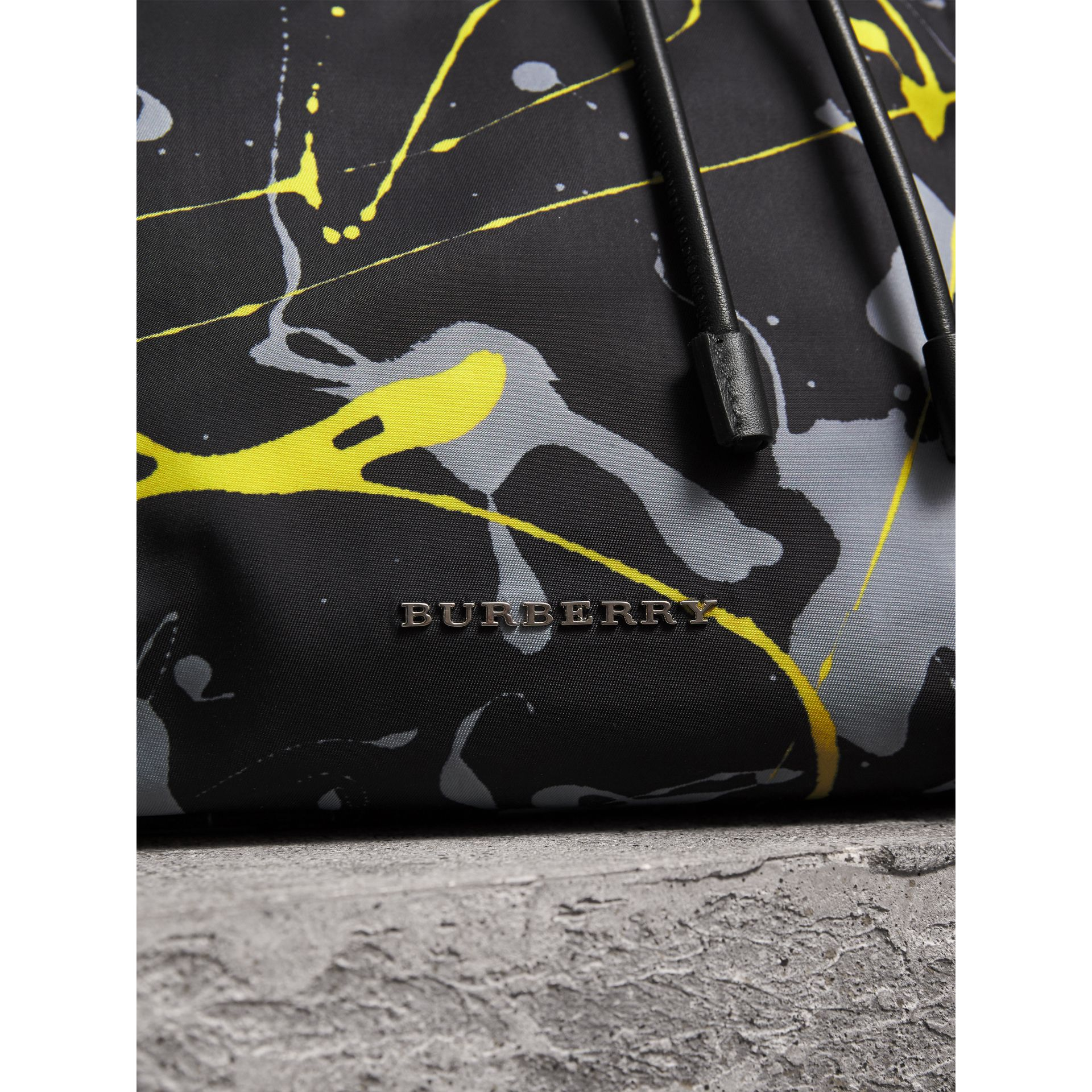 The Large Rucksack in Splash Print in Black/yellow - Men | Burberry United Kingdom - gallery image 1