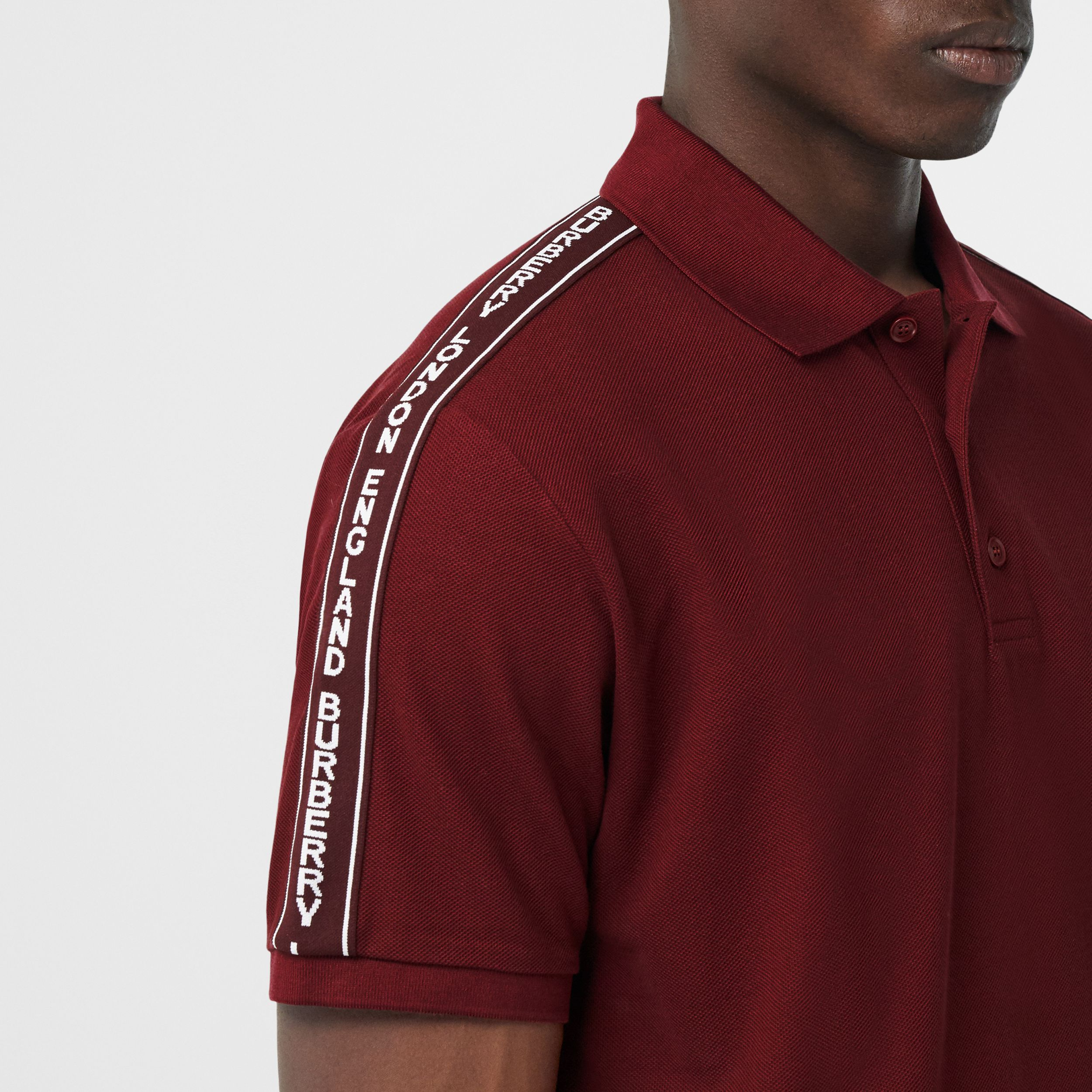 Logo Tape Cotton Piqué Polo Shirt in Deep Merlot - Men | Burberry - 2