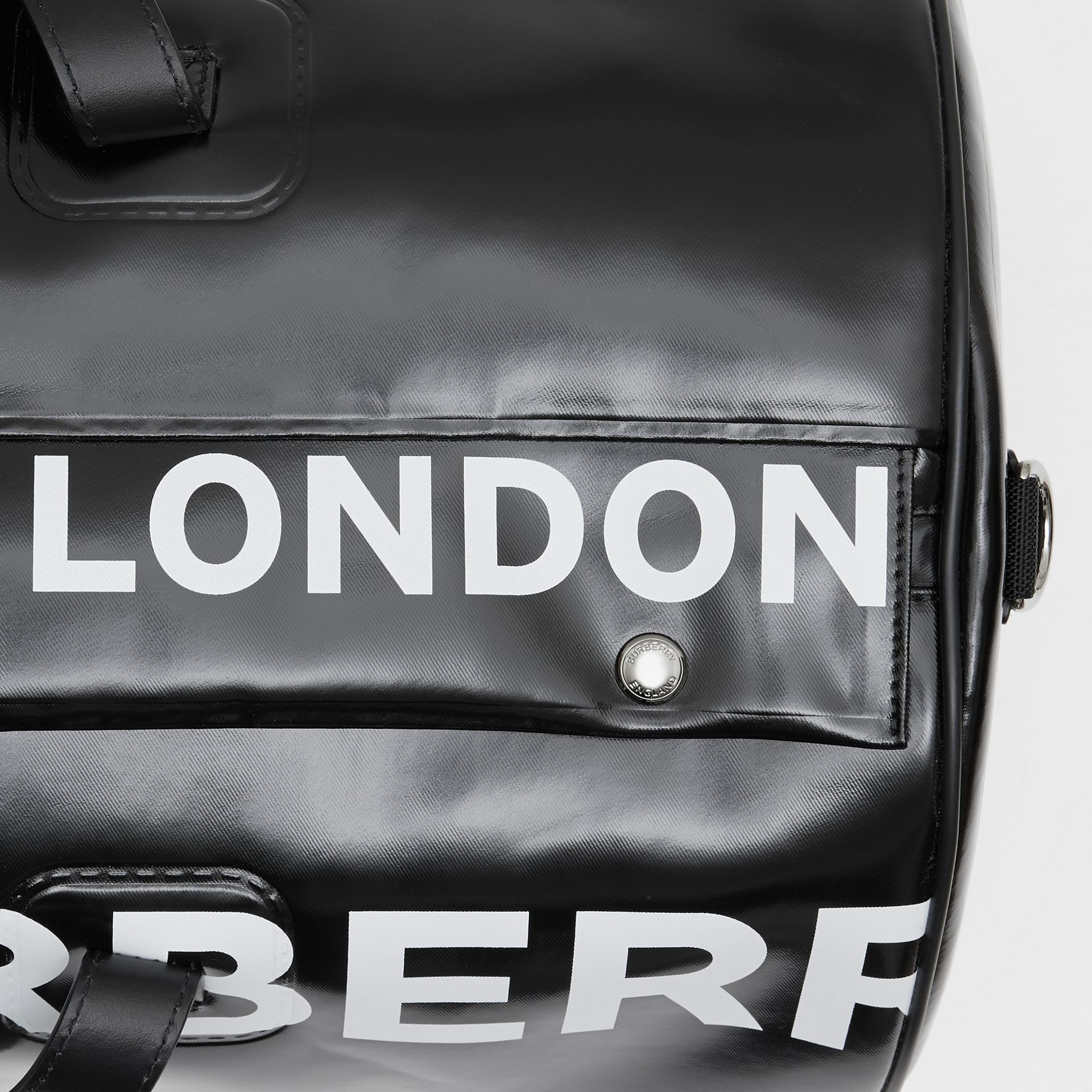 Large Horseferry Print Coated Canvas Barrel Bag in Black | Burberry United Kingdom - gallery image 1