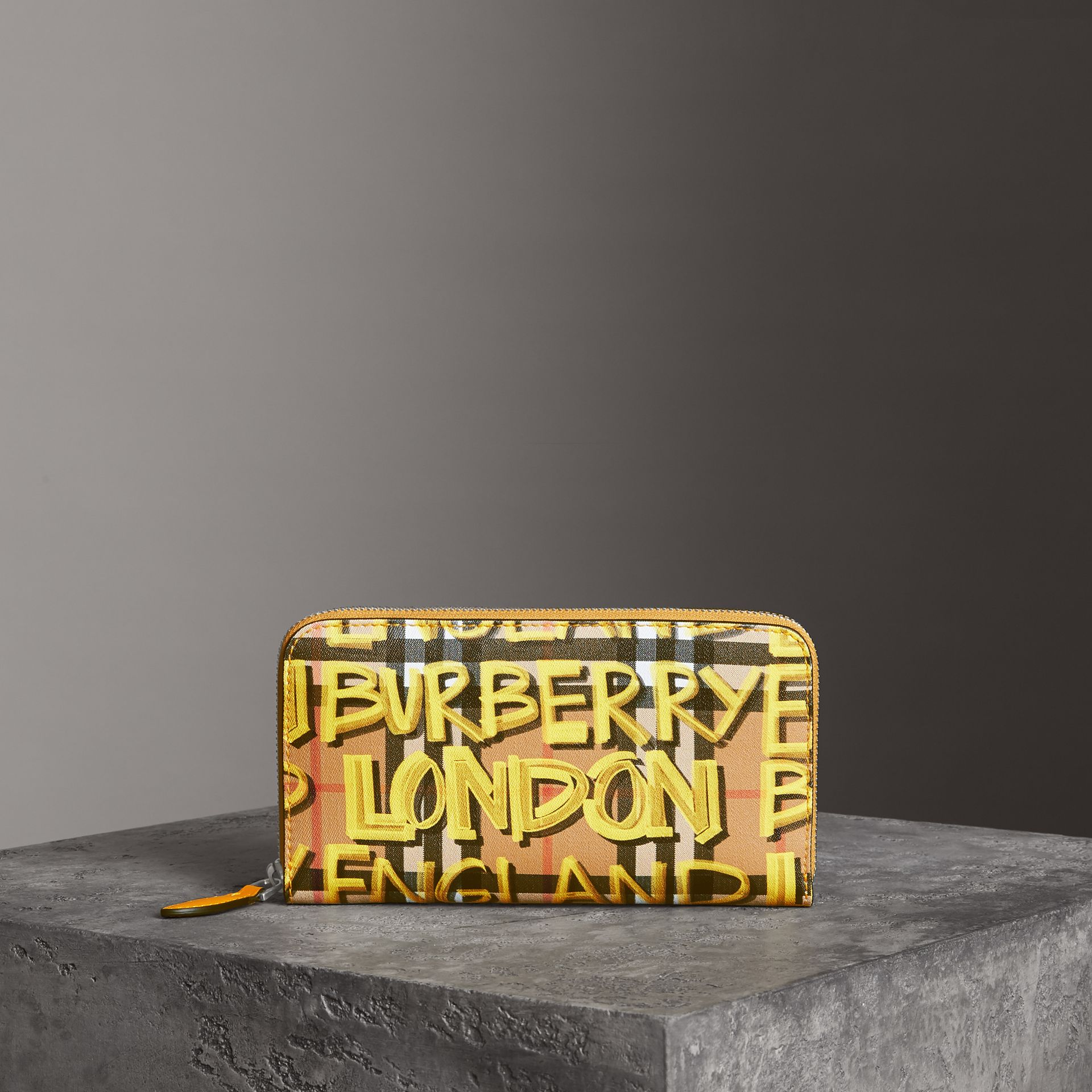 Graffiti Print Vintage Check Leather Ziparound Wallet in Yellow - Women | Burberry Canada - gallery image 0