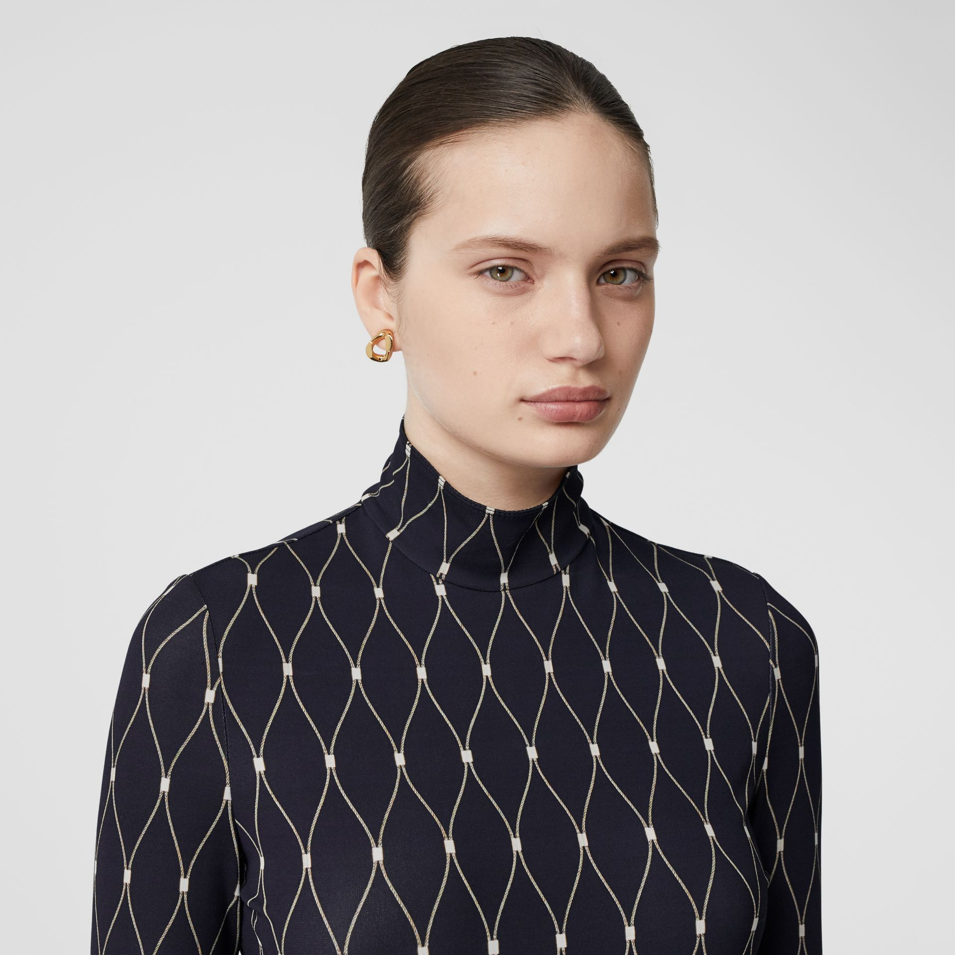 Net Print Stretch Jersey Turtleneck Top in Black - Women | Burberry - gallery image 1