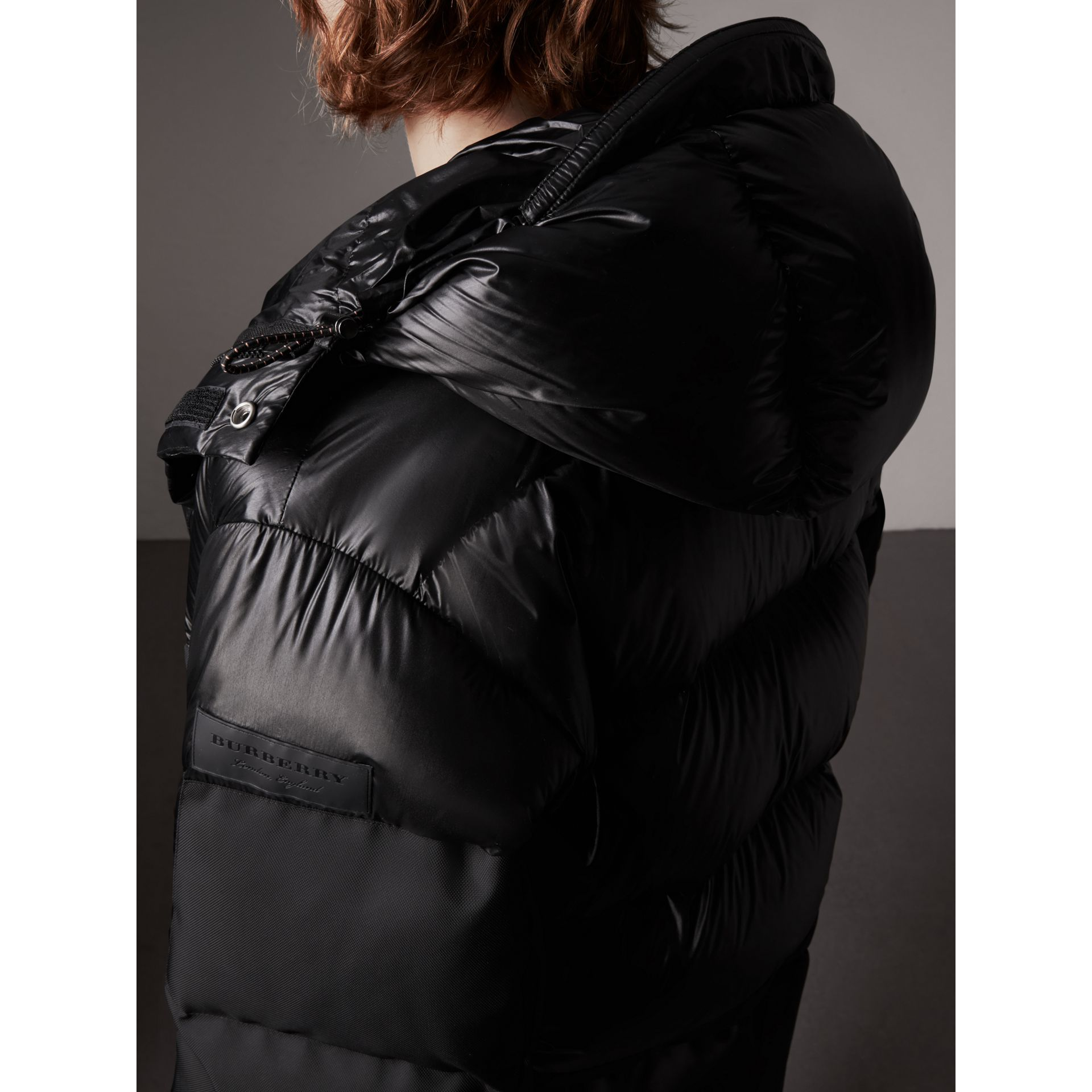 Oversized Down-filled Hooded Puffer Jacket in Black - Men | Burberry United States - gallery image 1
