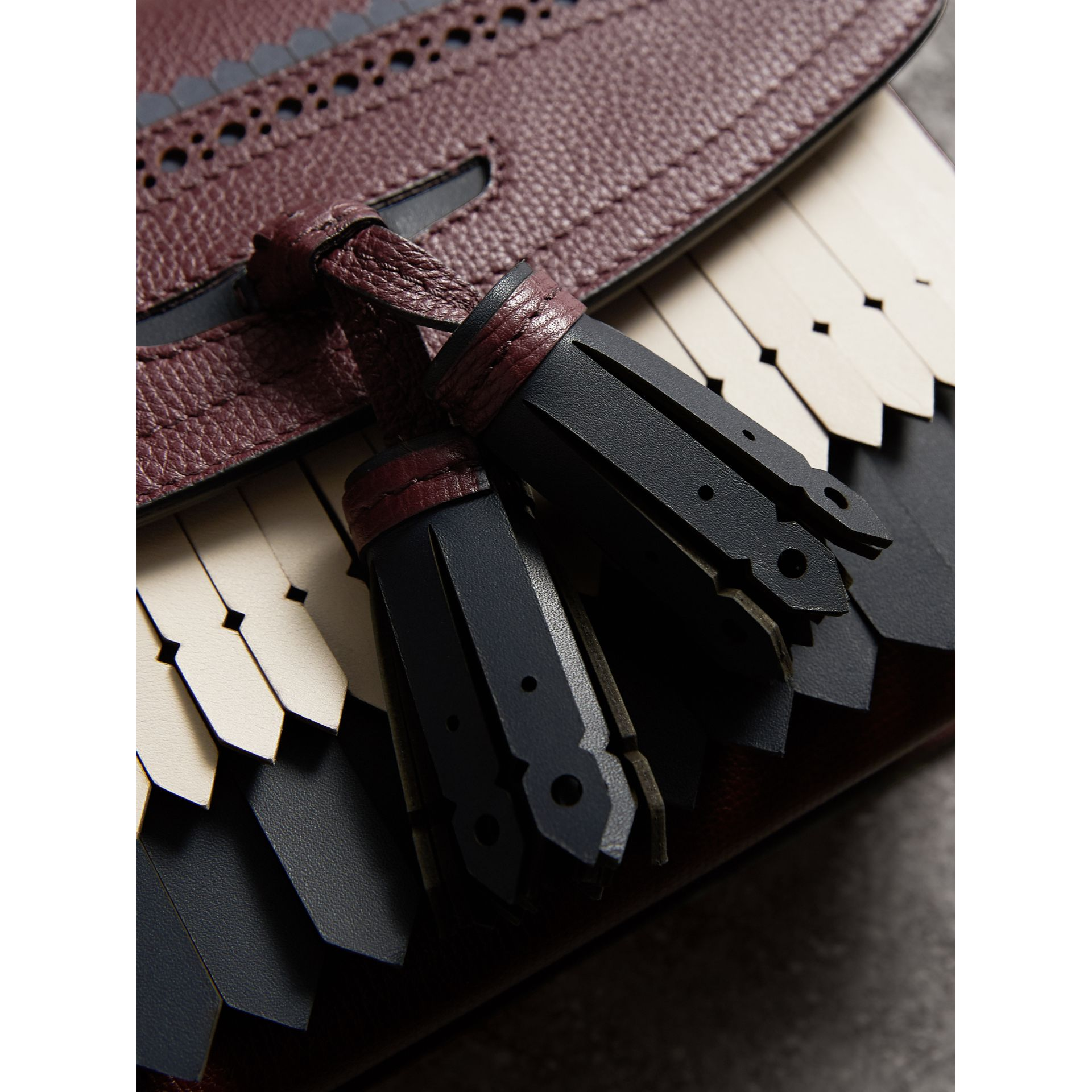Brogue and Fringe Detail Leather Crossbody Bag in Mahogany Red - Women | Burberry Singapore - gallery image 1