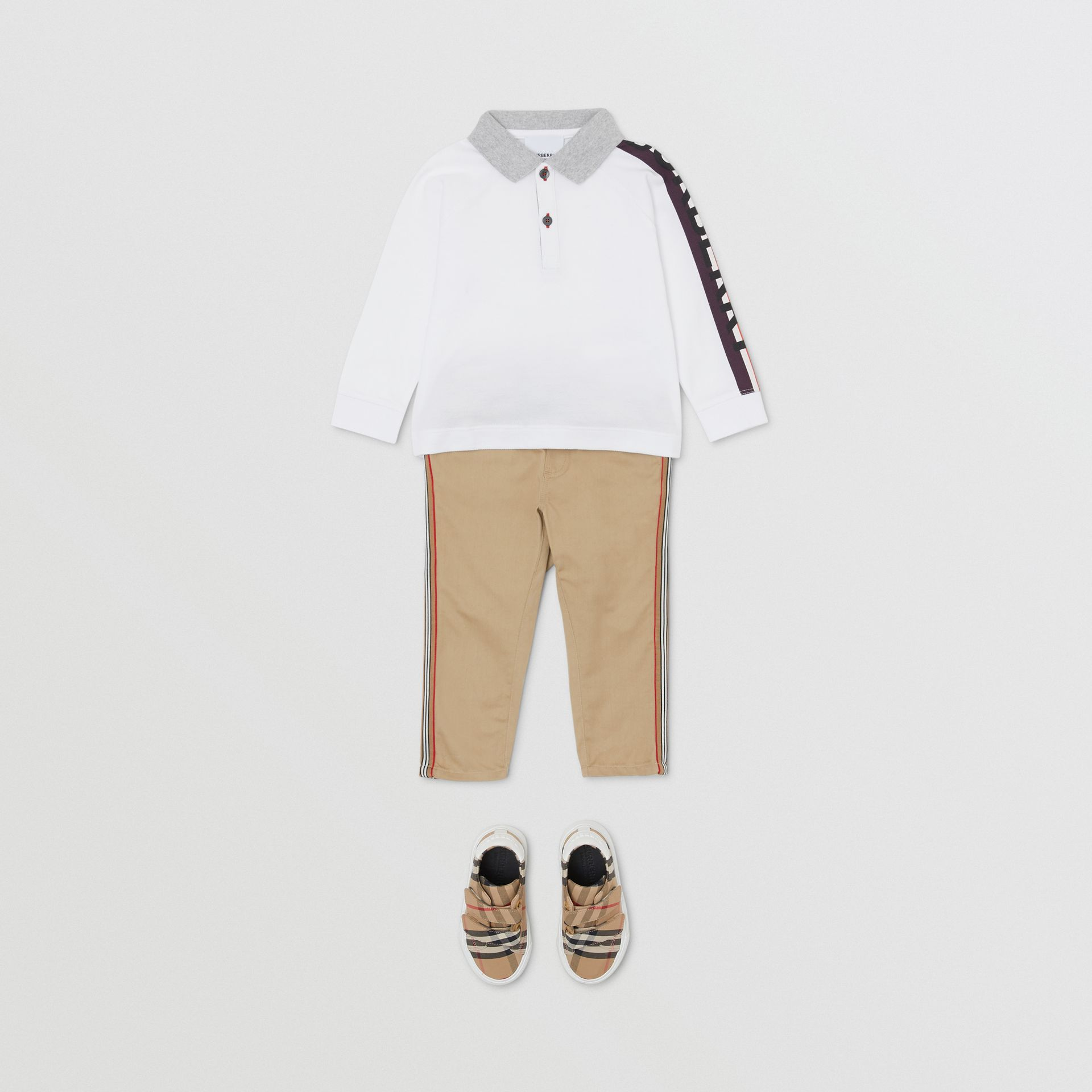 Long-sleeve Logo Print Cotton Polo Shirt in White - Children | Burberry - gallery image 2