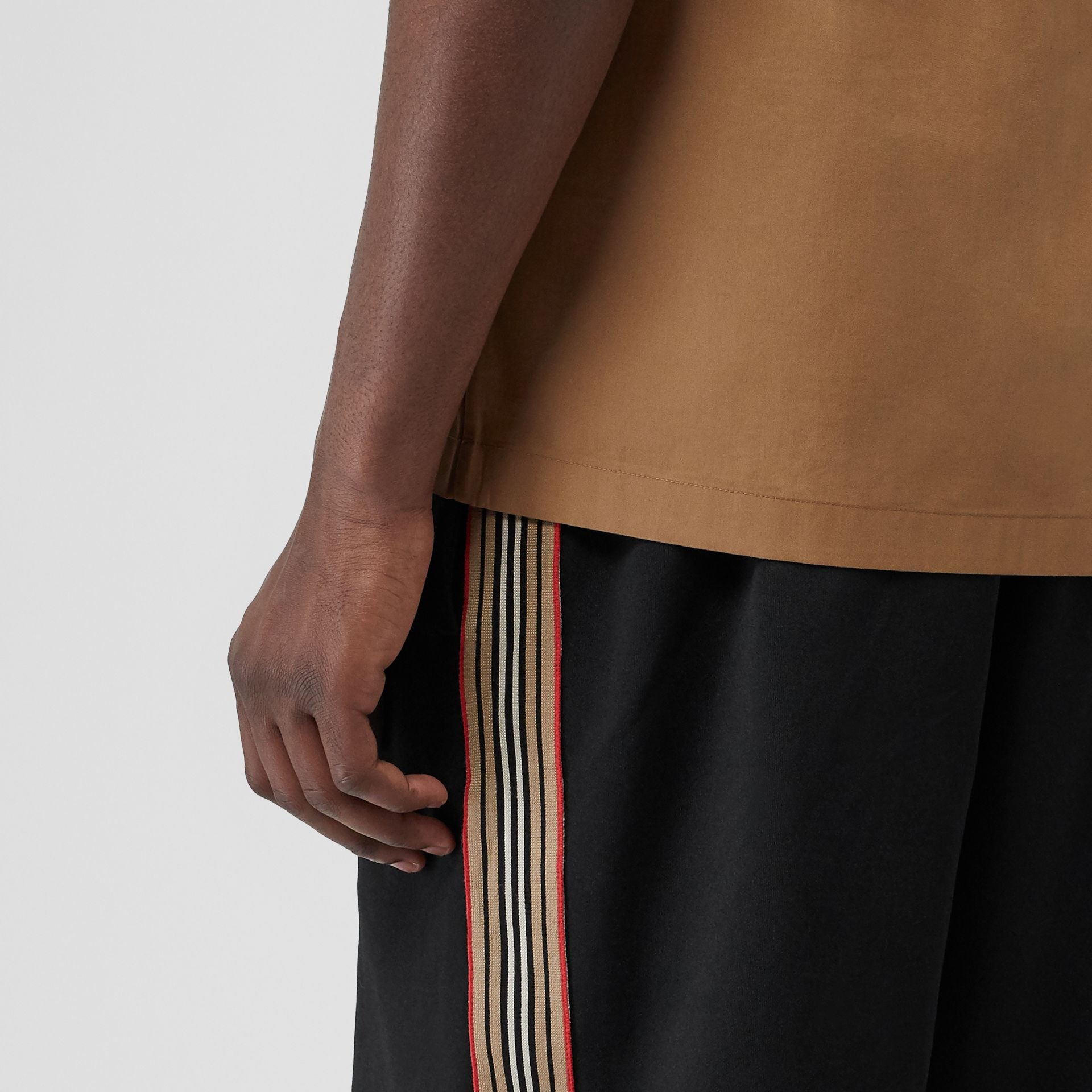 Icon Stripe Detail Cotton Blend Shorts in Black - Men | Burberry Singapore - gallery image 1