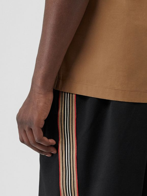 Icon Stripe Detail Cotton Blend Shorts in Black - Men | Burberry Singapore - cell image 1