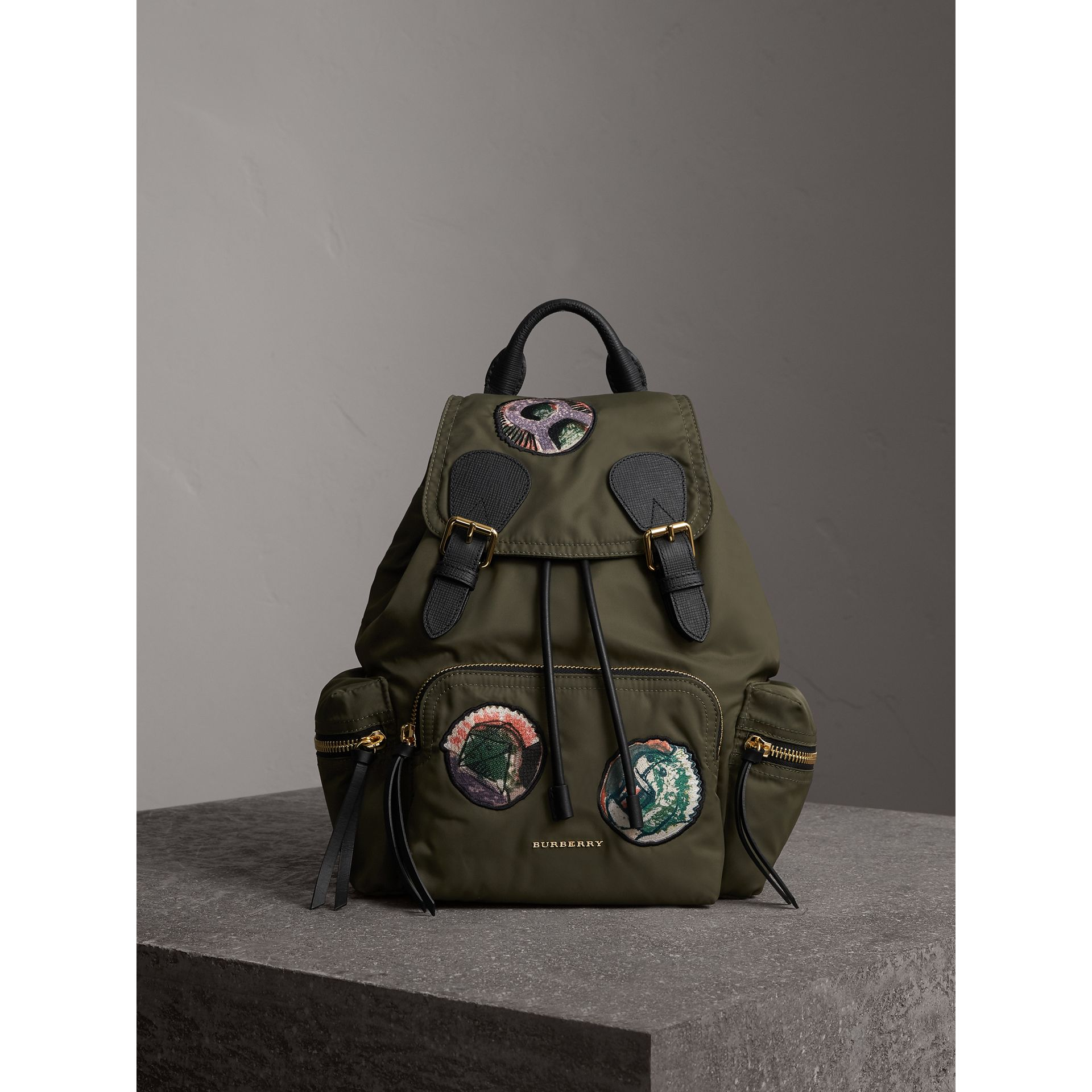 The Medium Rucksack in Technical Nylon with Pallas Heads Appliqué in Canvas Green - Women | Burberry - gallery image 1