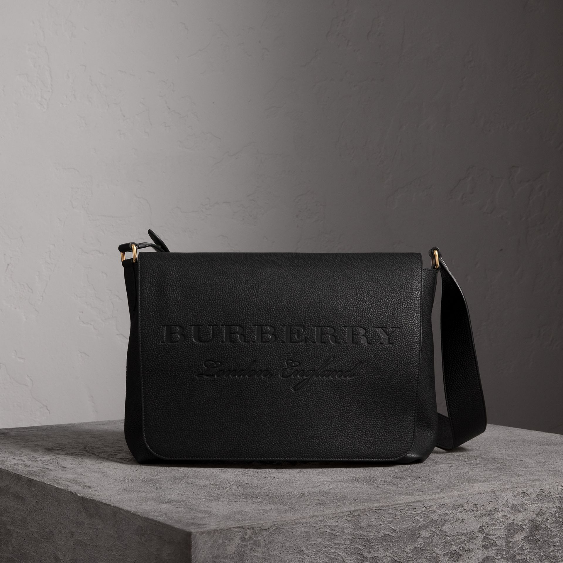 Large Embossed Leather Messenger Bag in Black | Burberry Singapore - gallery image 0