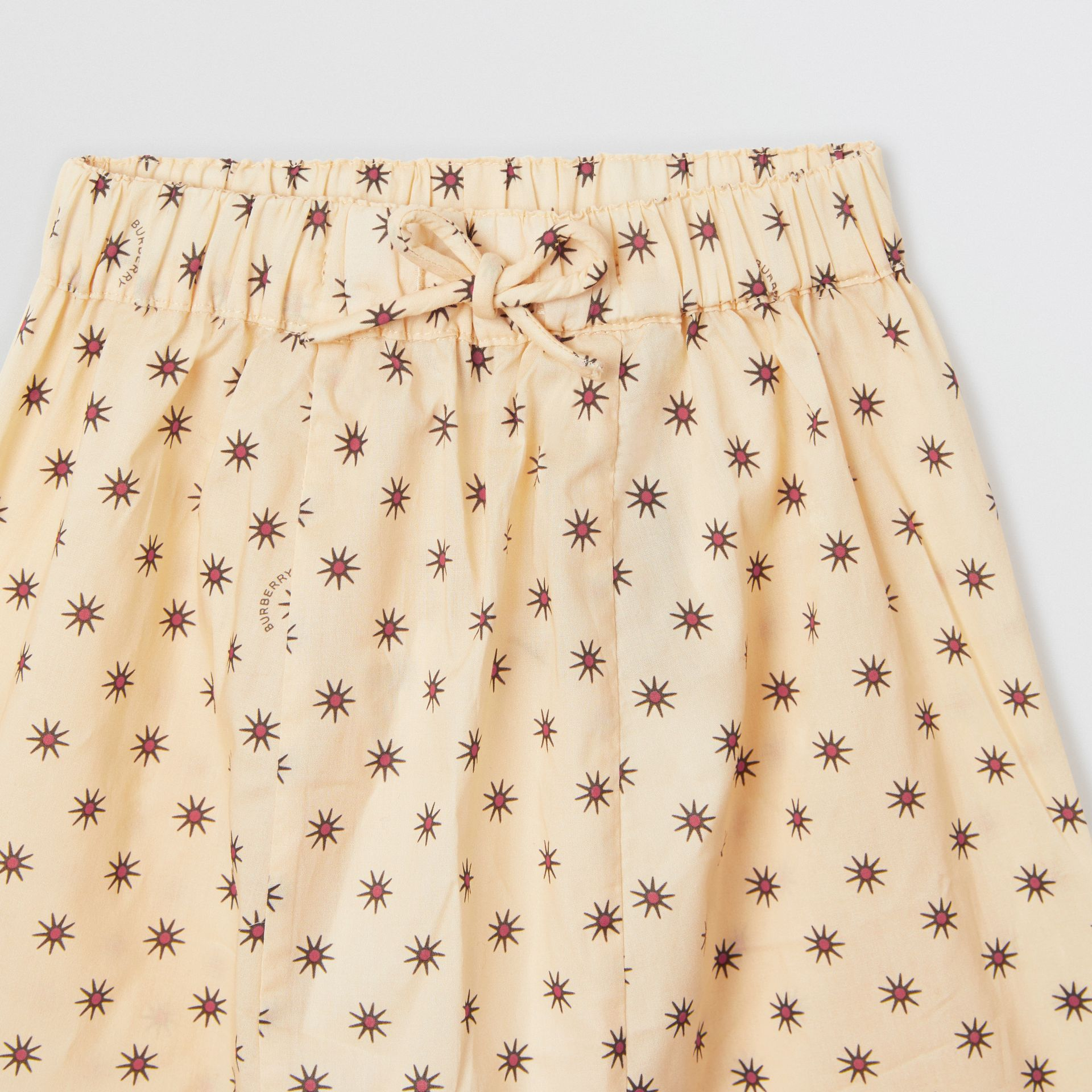Star Print Cotton Drawcord Trousers in Military Red - Children | Burberry - gallery image 1
