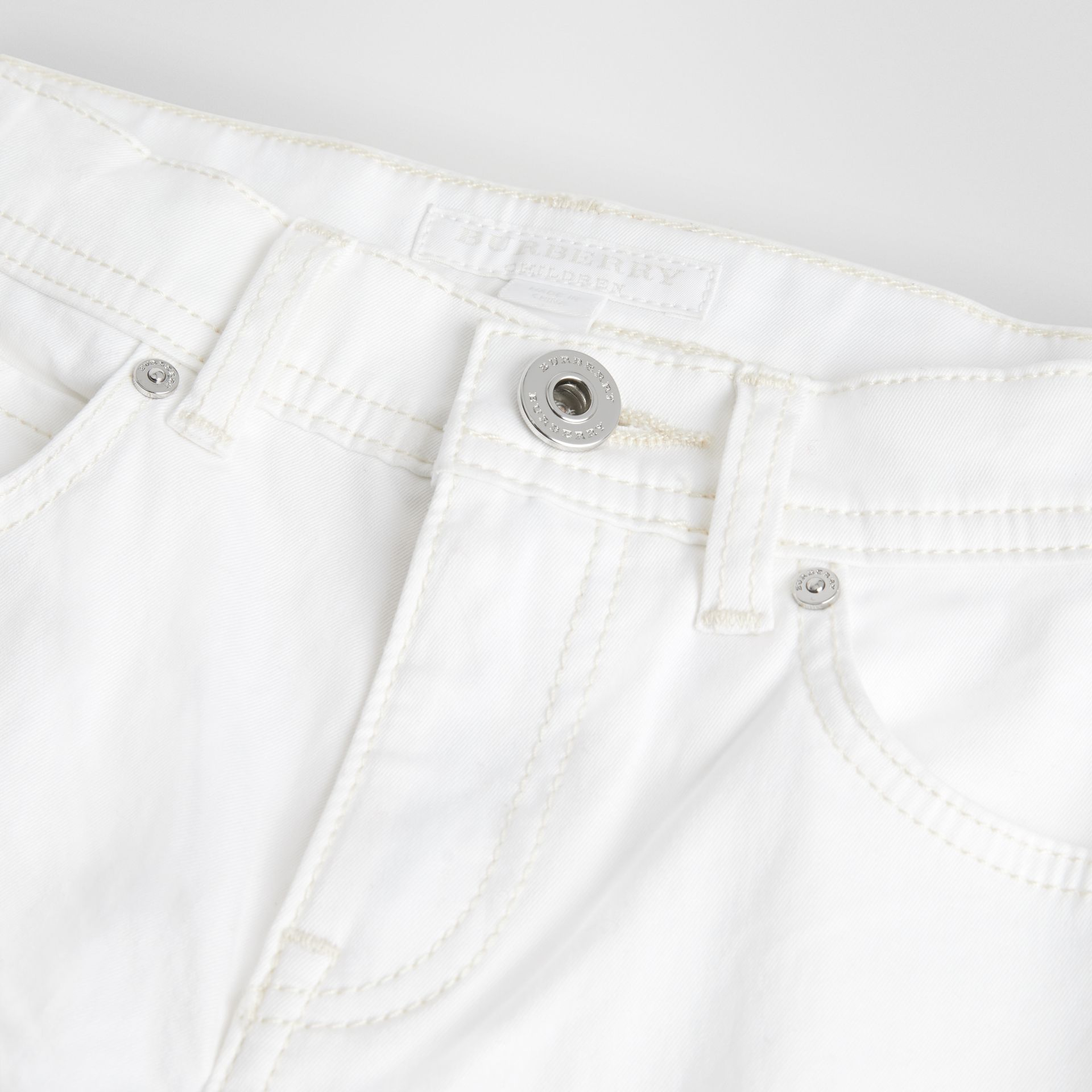 Relaxed Fit Stretch Denim Shorts in White - Girl | Burberry Canada - gallery image 1