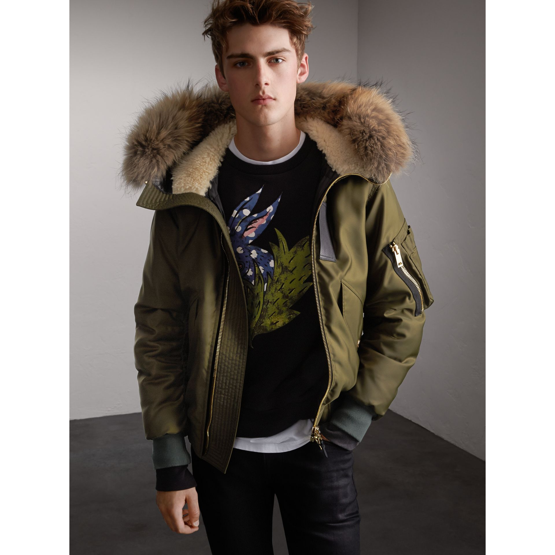 Raccoon Fur and Shearling Hood Duck-down Jacket in Caper Green - Men | Burberry - gallery image 1