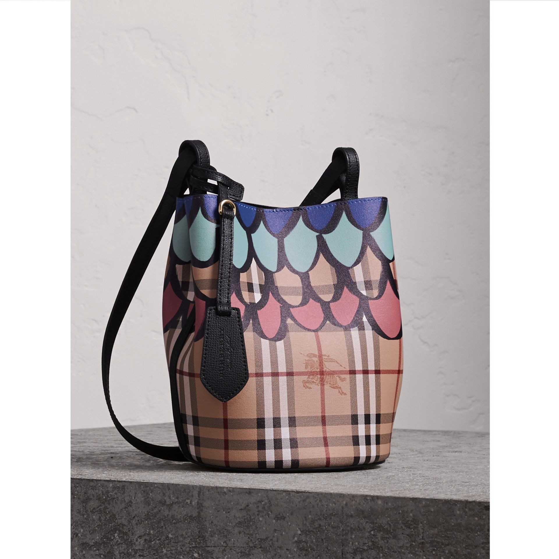 Trompe L'oeil Print Crossbody Bucket Bag in Black - Women | Burberry Singapore - gallery image 1