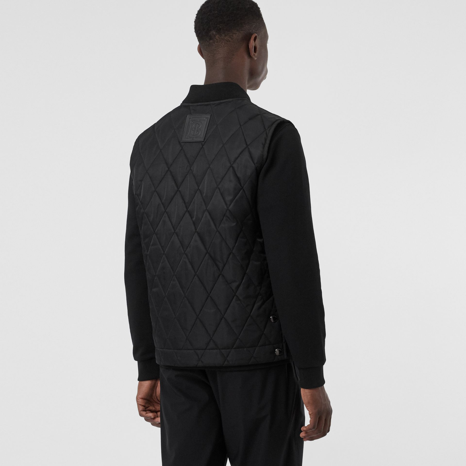 Monogram Motif Diamond Quilted Gilet in Black - Men | Burberry - gallery image 1