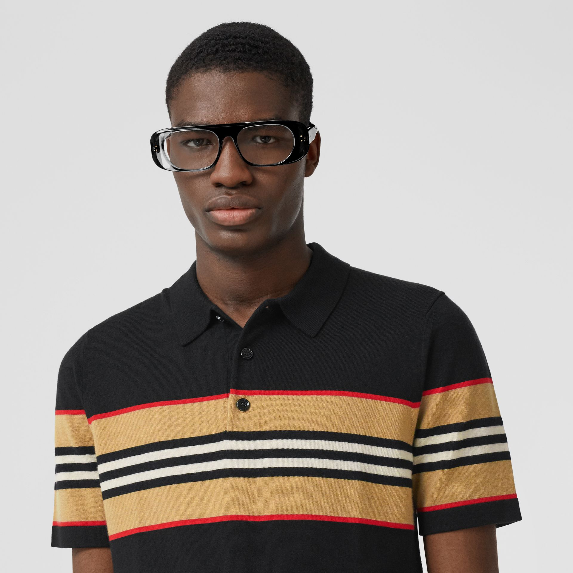 Icon Stripe Detail Merino Wool Polo Shirt in Black - Men | Burberry - gallery image 1