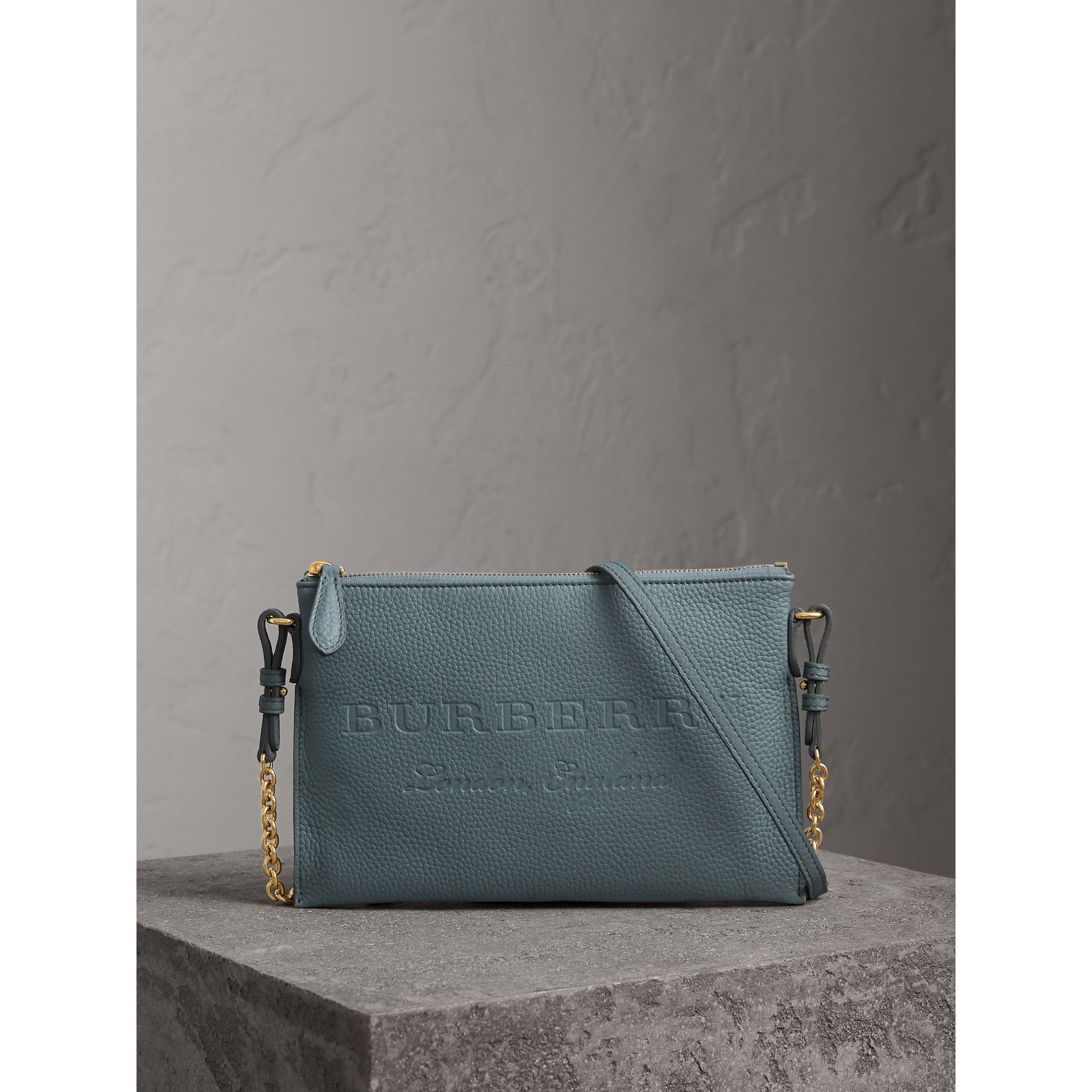 Embossed Leather Clutch Bag in Dusty Teal Blue - Women | Burberry United Kingdom - gallery image 1