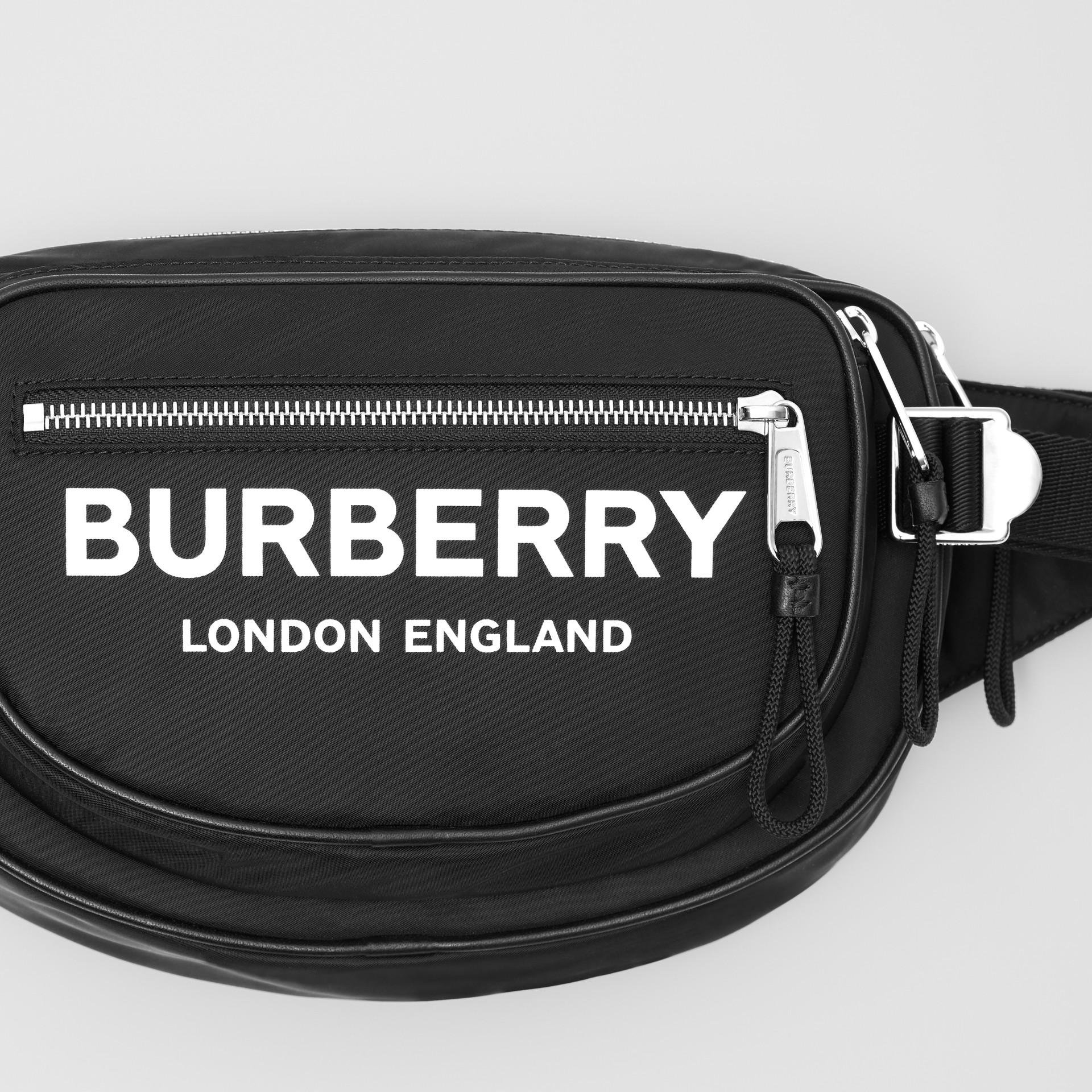 Medium Logo Print ECONYL® Cannon Bum Bag in Black - Men | Burberry United Kingdom - gallery image 1
