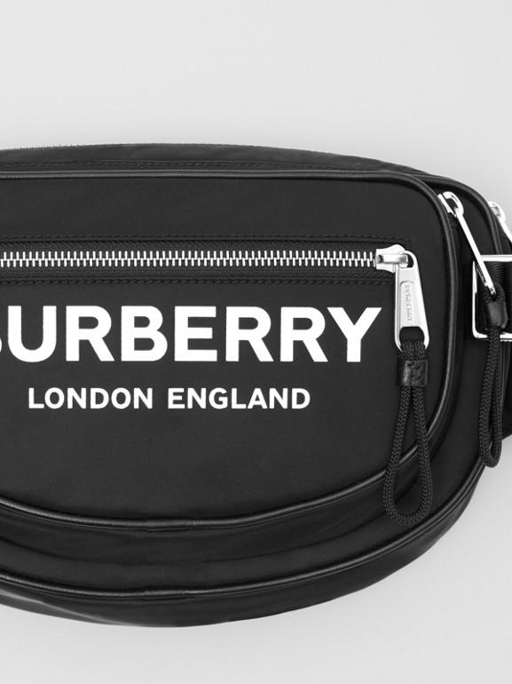 Medium Logo Print ECONYL® Cannon Bum Bag in Black - Men | Burberry United Kingdom - cell image 1