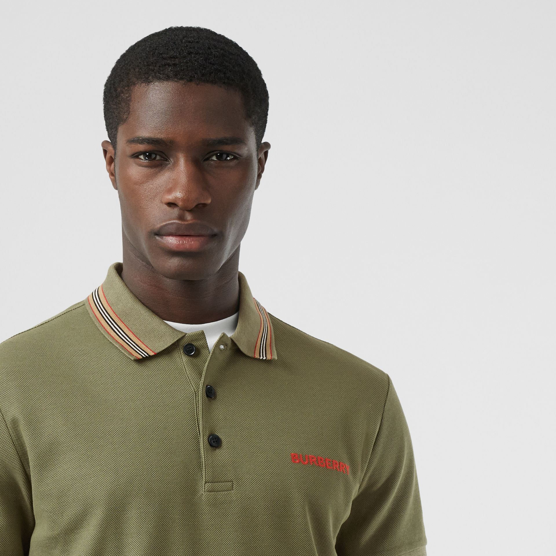 Icon Stripe Detail Cotton Piqué Polo Shirt in Poplar Green - Men | Burberry - gallery image 1