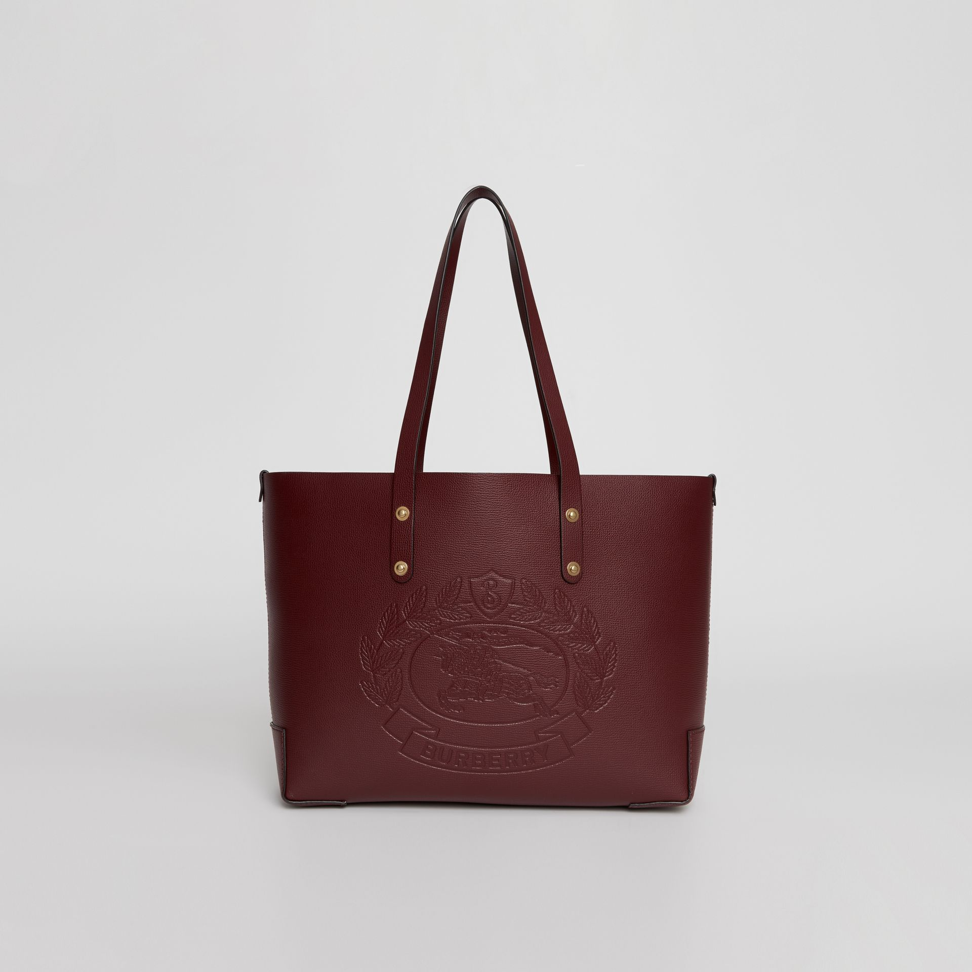 Small Embossed Crest Leather Tote in Burgundy | Burberry Australia - gallery image 0
