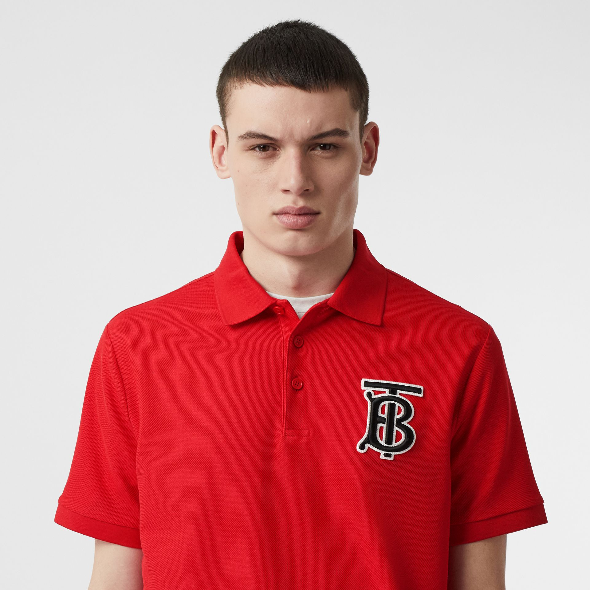 Monogram Motif Cotton Piqué Oversized Polo Shirt in Bright Red - Men | Burberry United Kingdom - gallery image 1
