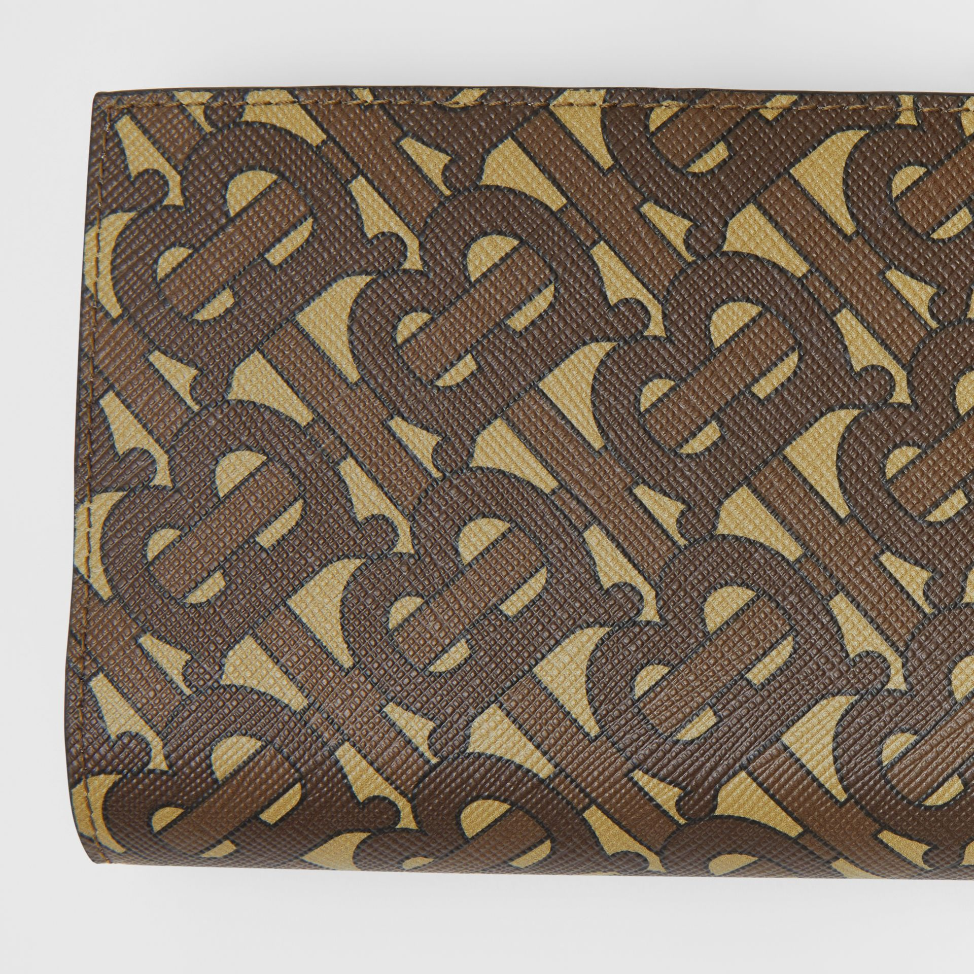 Monogram Print E-canvas Continental Wallet in Bridle Brown - Men | Burberry - gallery image 1