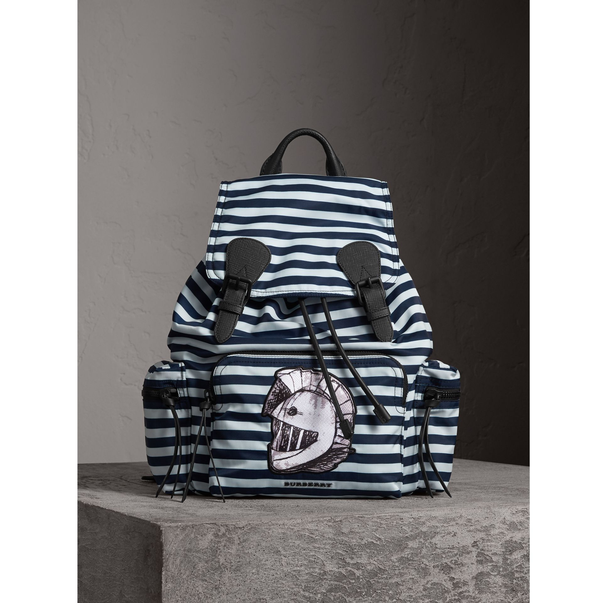 The Large Rucksack in Striped Nylon with Pallas Helmet Motif in Bright Cyan Blue - Men | Burberry - gallery image 0