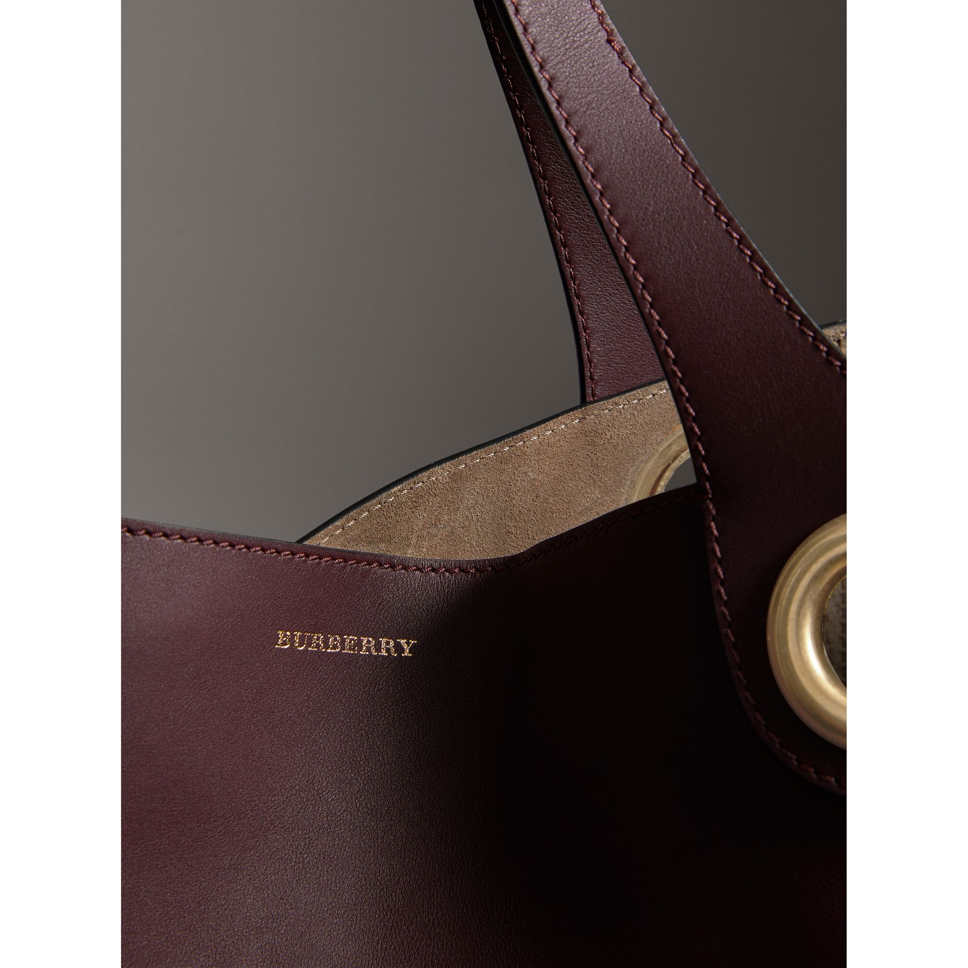 The Large Leather Grommet Detail Tote in Deep Claret | Burberry - gallery image 1