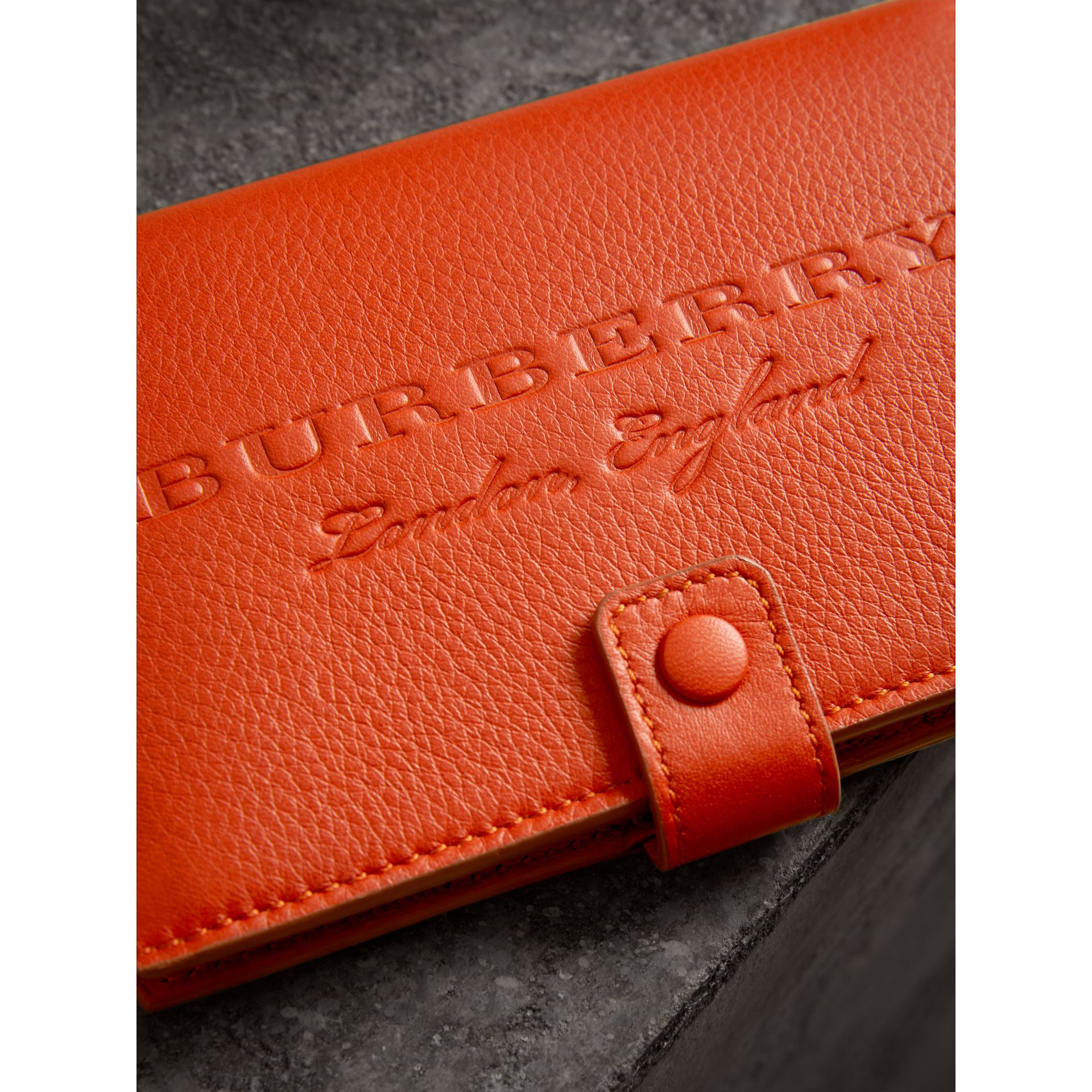 Embossed Grainy Leather Folding Wallet in Dark Clementine | Burberry - gallery image 1