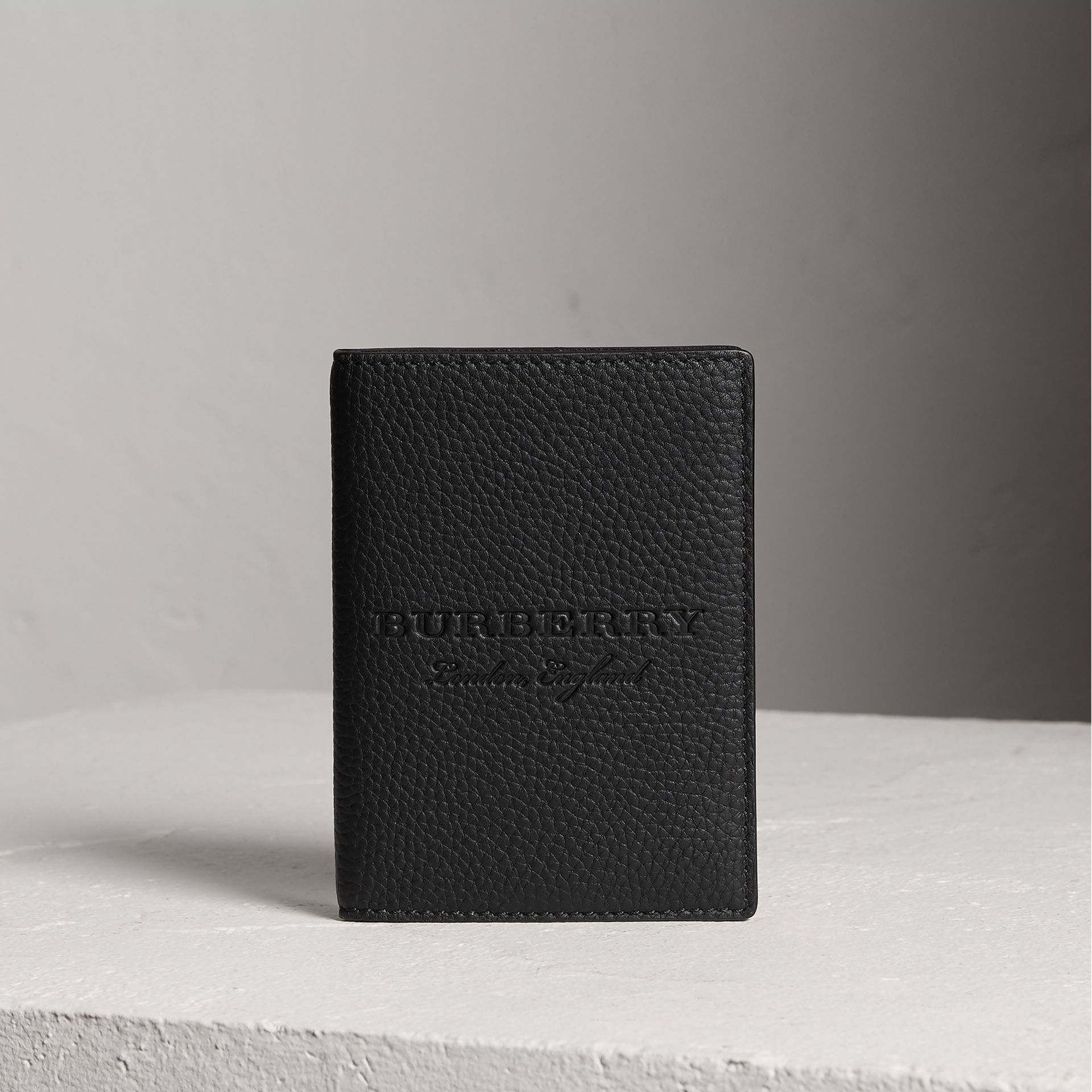 Embossed Leather Passport Holder in Black | Burberry - gallery image 0