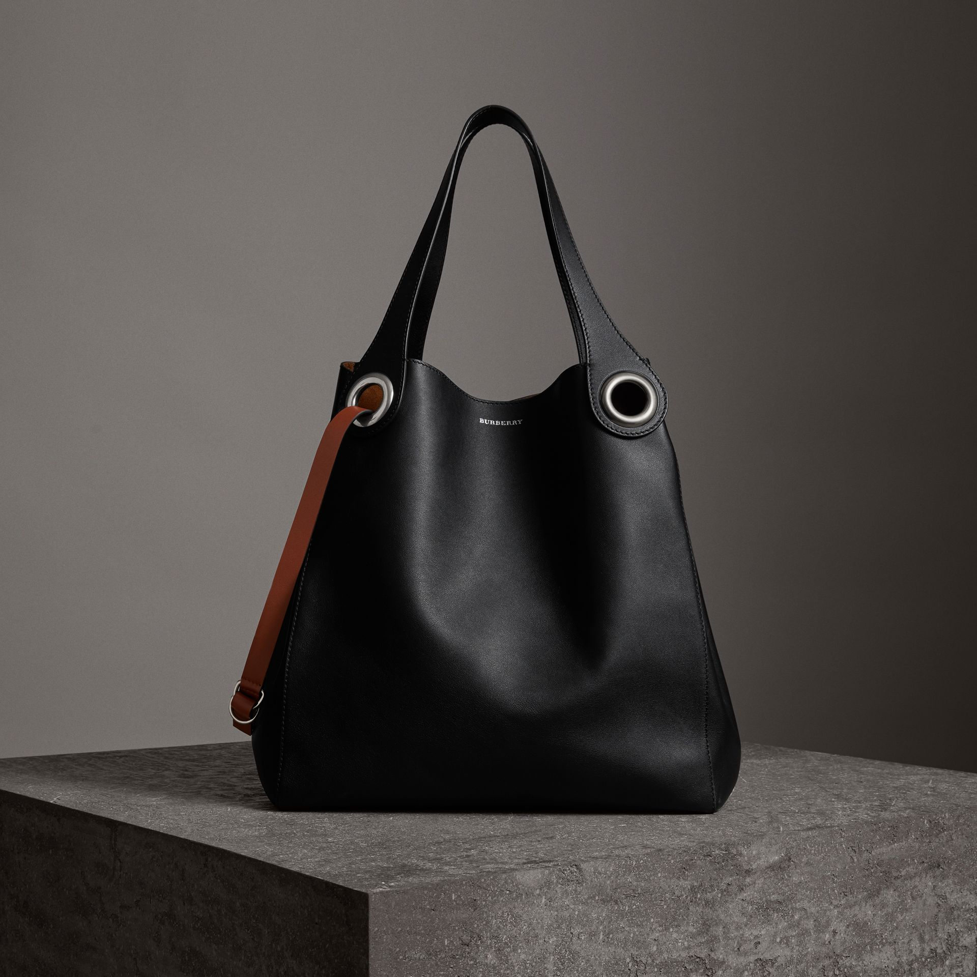 The Large Leather Grommet Detail Tote in Black | Burberry Australia - gallery image 0