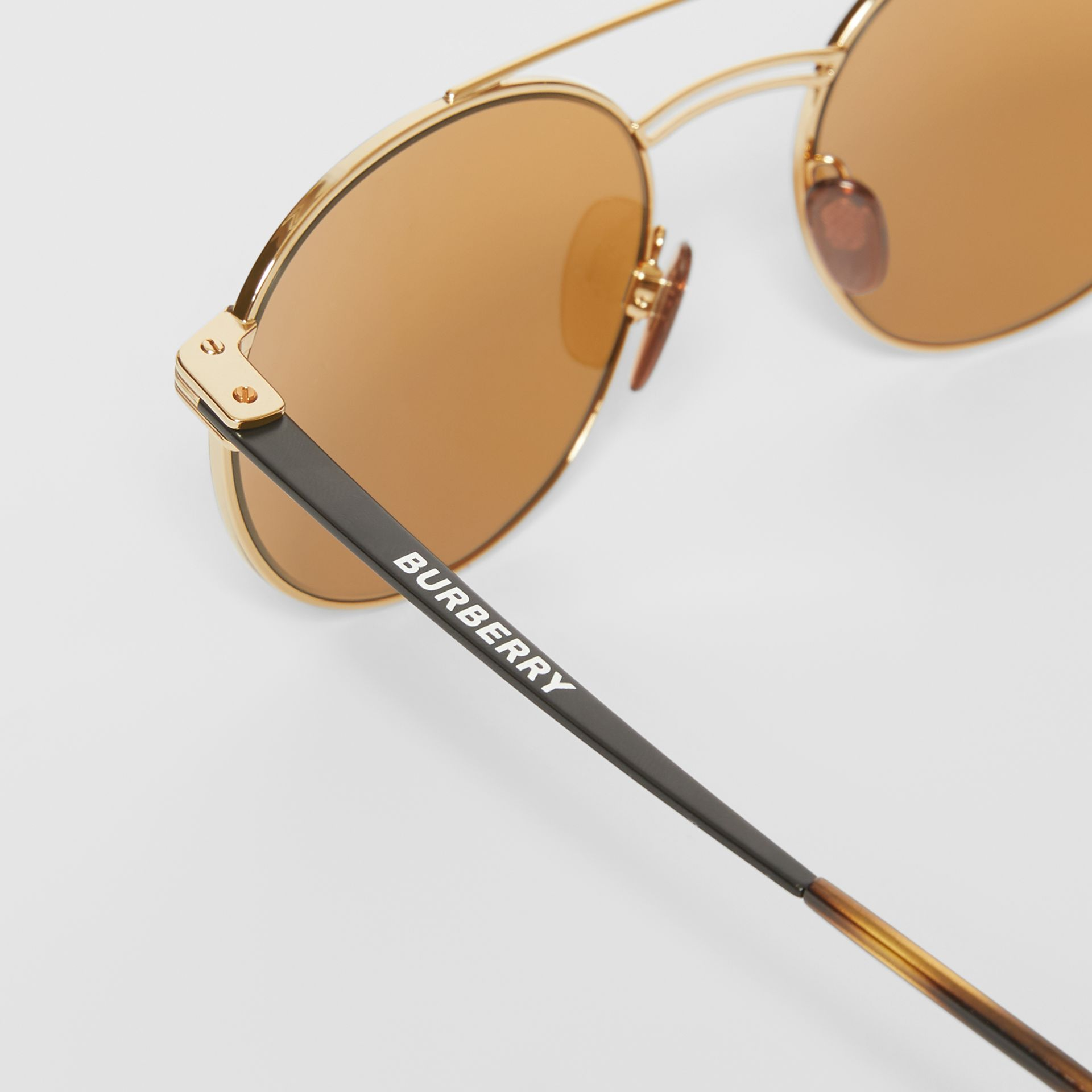 Top Bar Detail Round Frame Sunglasses in Tortoiseshell - Men | Burberry - gallery image 1