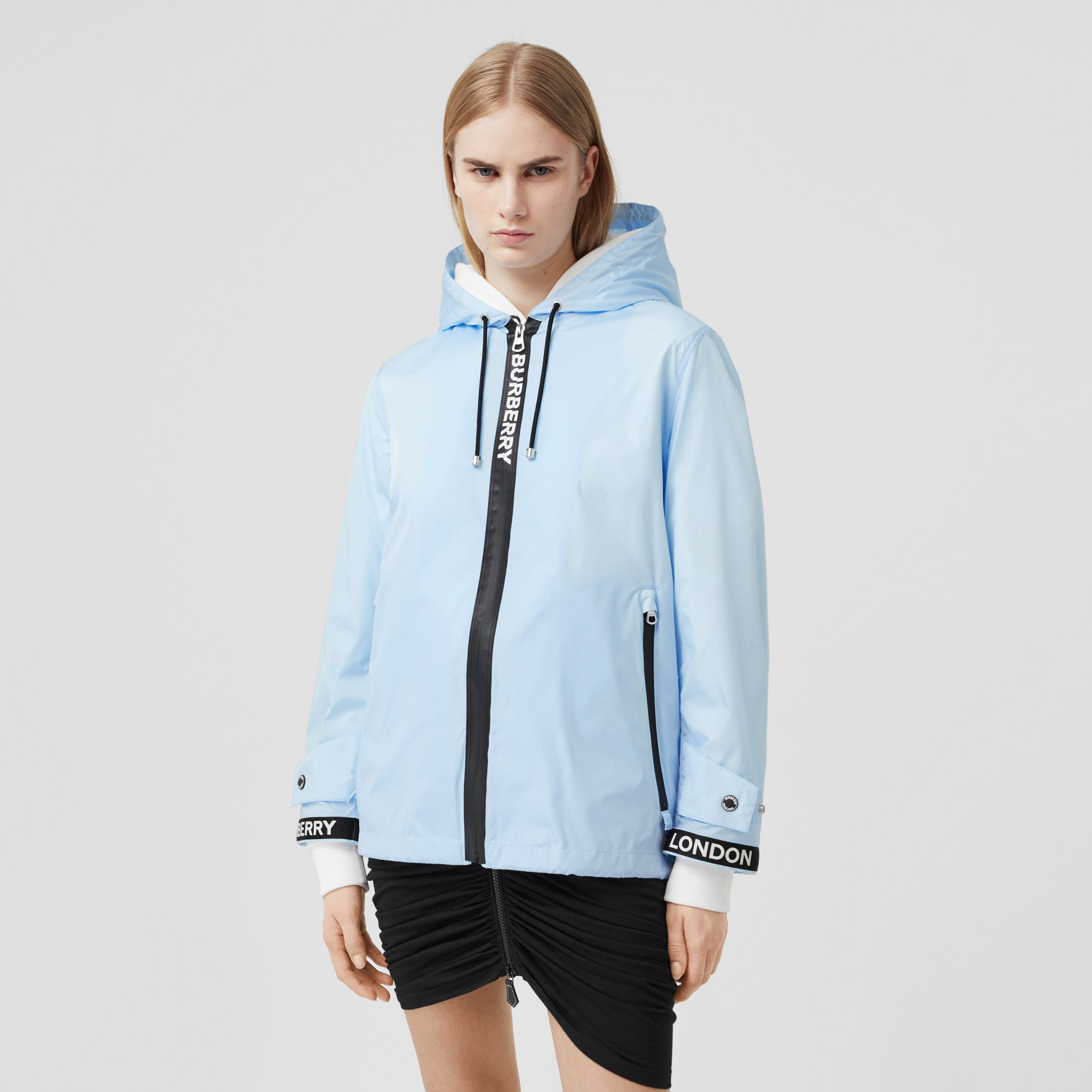 Logo Tape ECONYL® Hooded Jacket in Pale Blue - Women | Burberry - 1