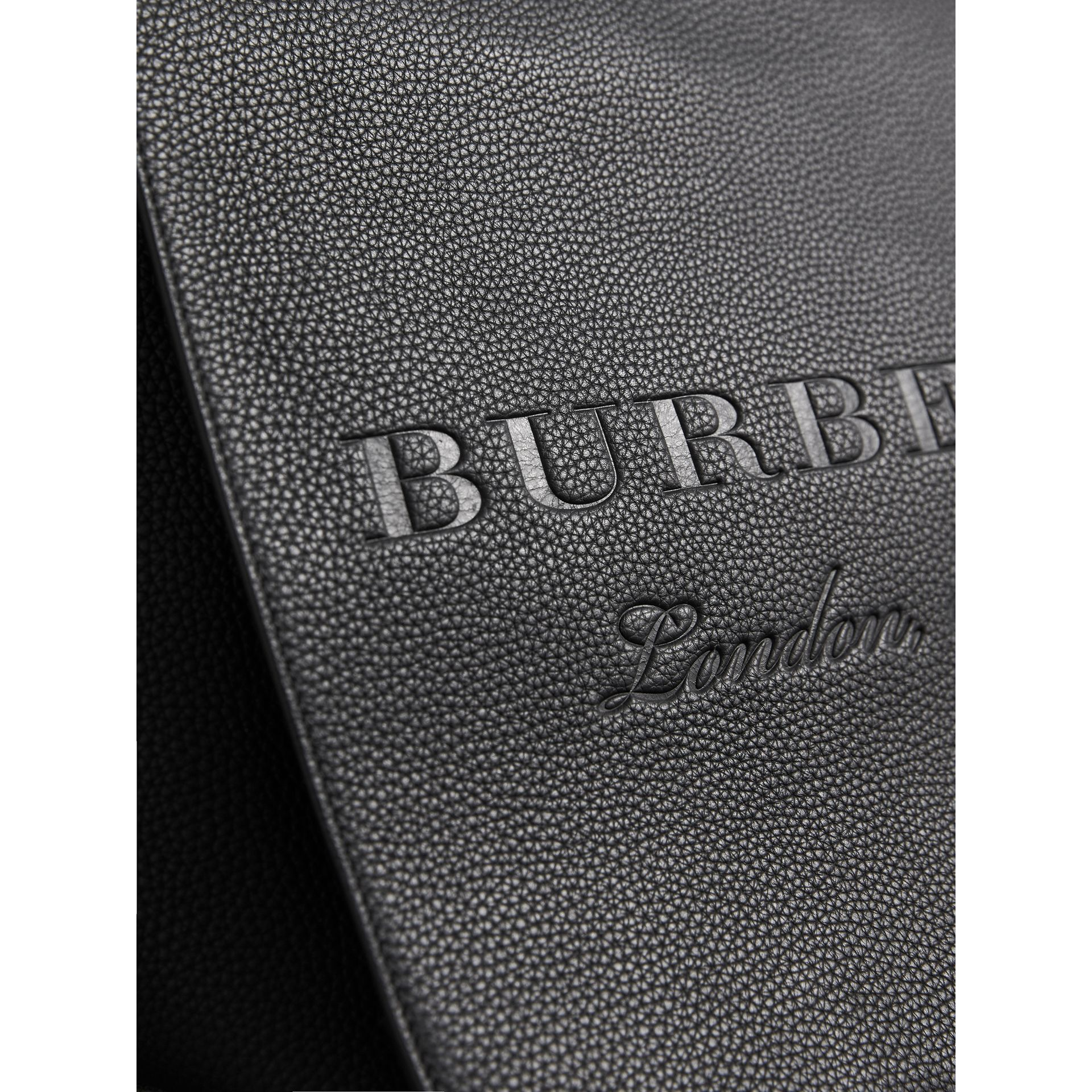 Large Embossed Leather Messenger Bag in Black | Burberry Singapore - gallery image 1