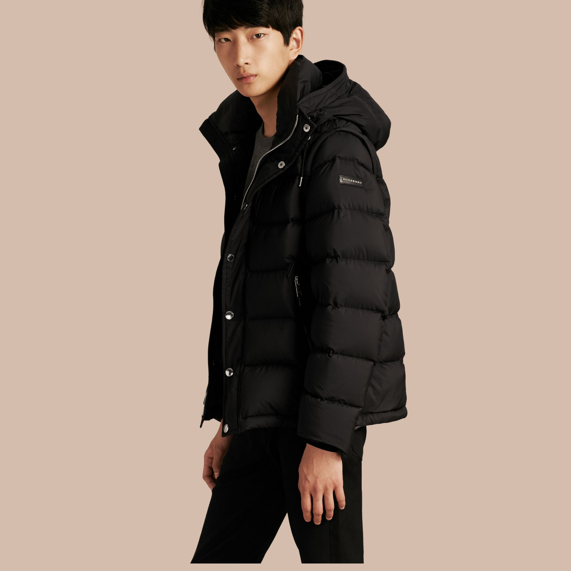 Down-filled Hooded Jacket with Detachable Sleeves in Black - gallery image 1