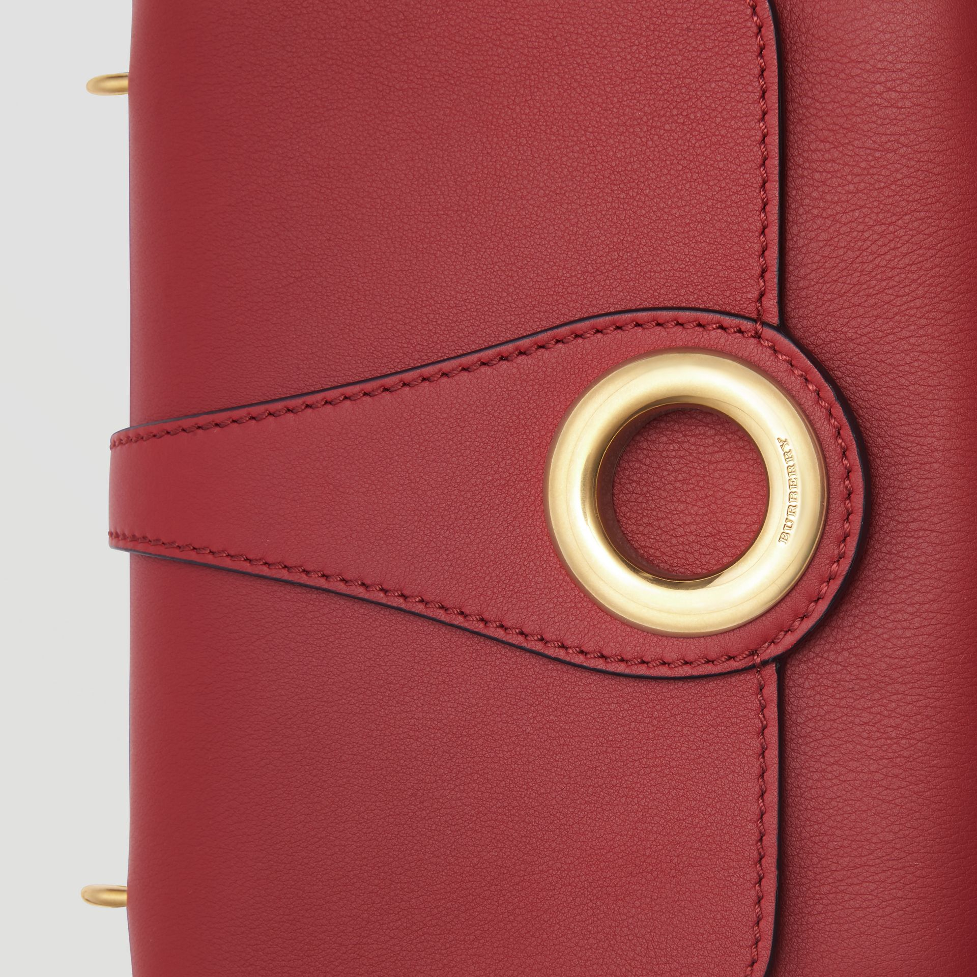 The Leather Grommet Detail Crossbody Bag in Crimson - Women | Burberry United Kingdom - gallery image 1