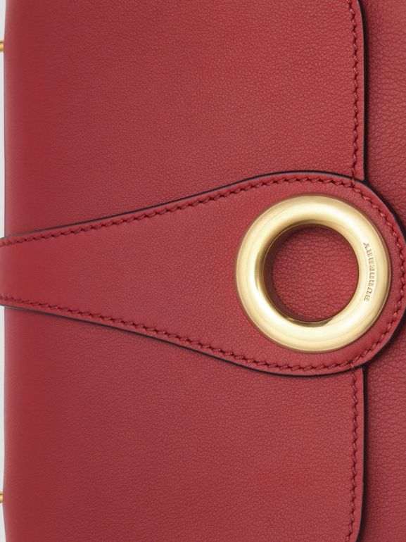 The Leather Grommet Detail Crossbody Bag in Crimson - Women | Burberry - cell image 1