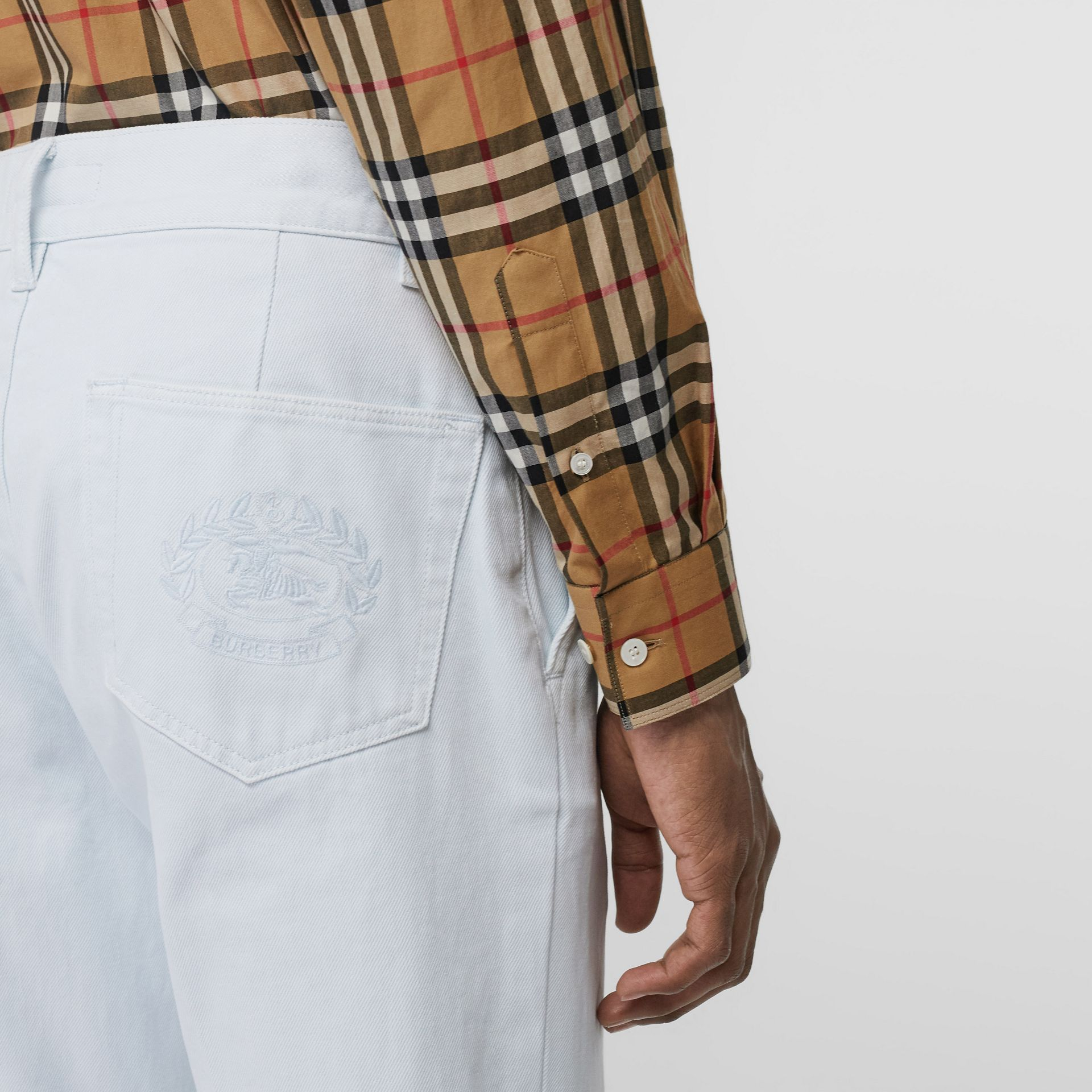 Embroidered Crest Relaxed Fit Jeans in Chalk Blue - Men | Burberry - gallery image 1