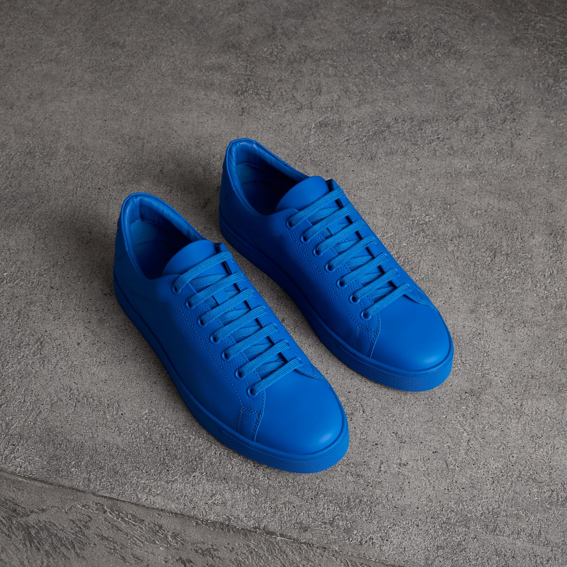 Perforated Check Leather Sneakers in Bright Sky Blue - Men | Burberry - gallery image 0