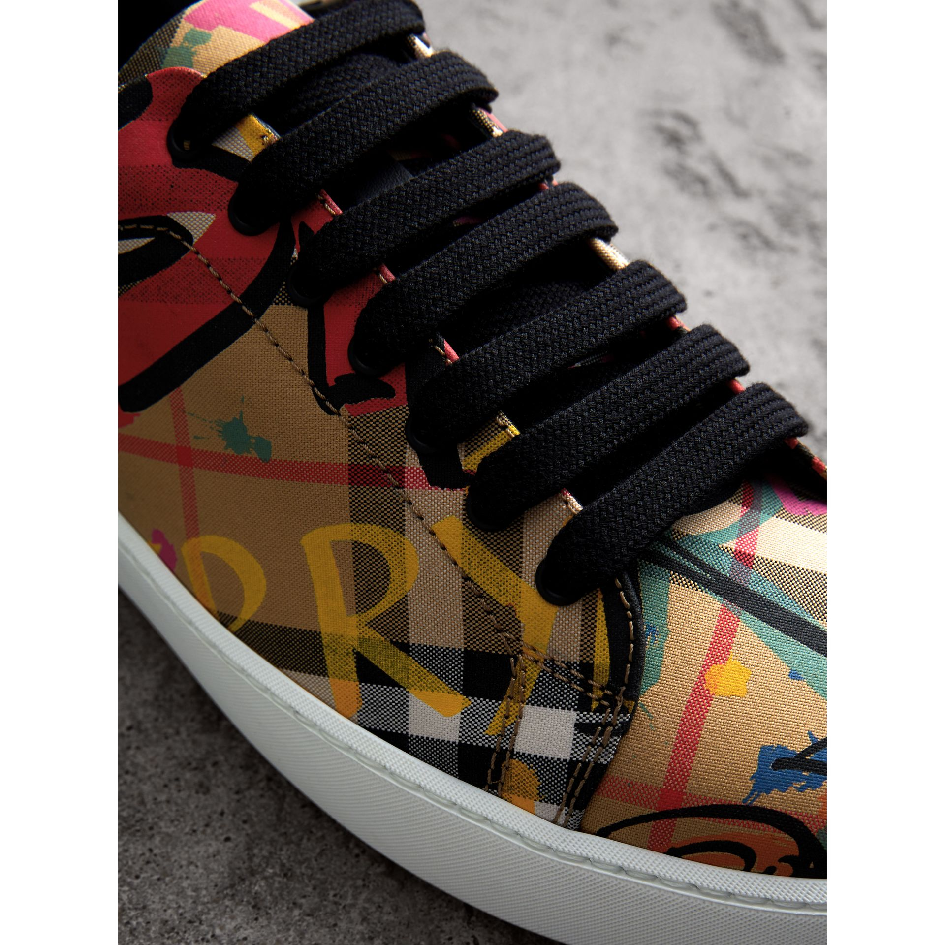 Graffiti Print Vintage Check Sneakers in Antique Yellow - Women | Burberry Canada - gallery image 1