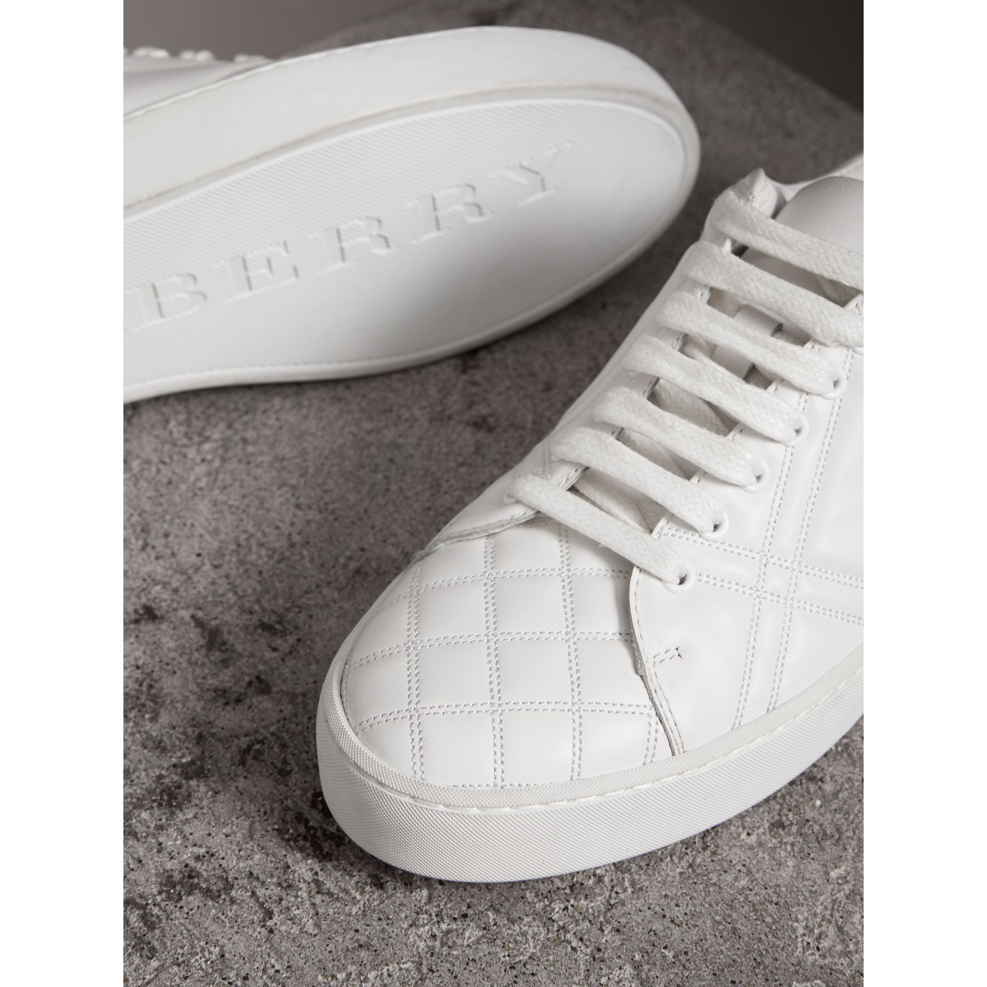 Check-quilted Leather Trainers in Optic White - Women | Burberry - gallery image 2