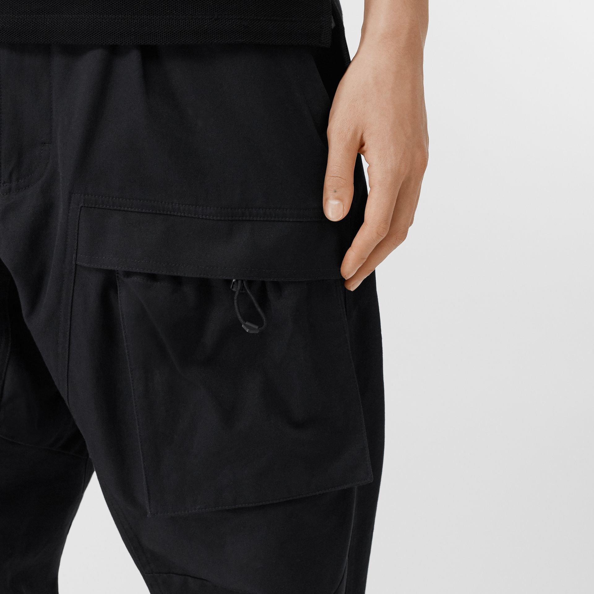 Cotton Cargo Trousers in Black - Men | Burberry - gallery image 1