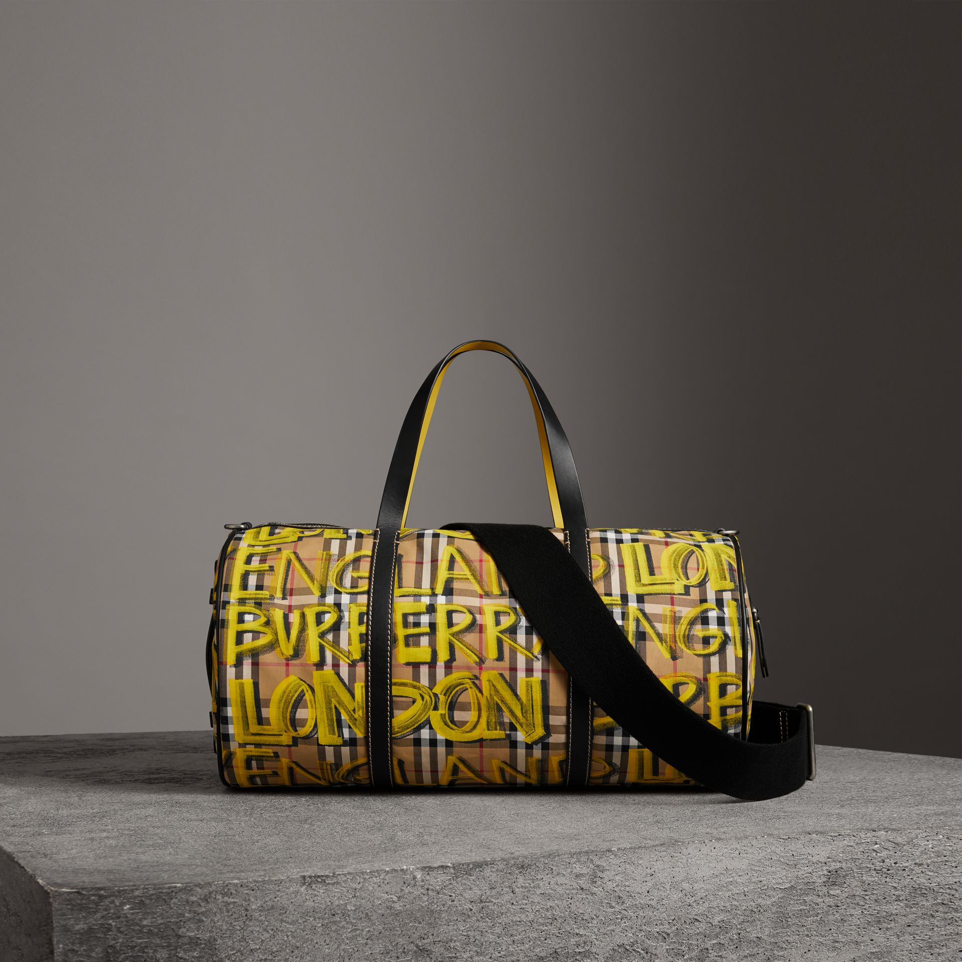 Medium Graffiti Print Vintage Check Barrel Bag in Bright Yellow/antique Yellow - Men | Burberry Singapore - gallery image 0